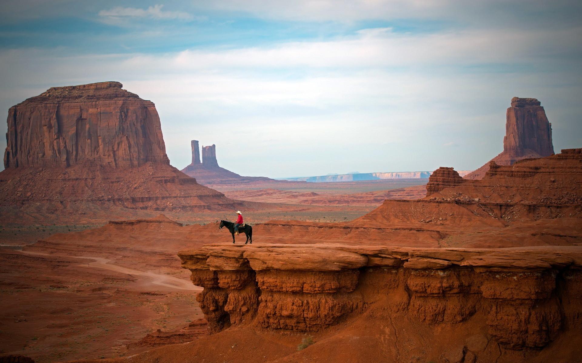 cowboy west hat people places nature landscapes canyon cliffs desert sky  clouds mood wallpaper