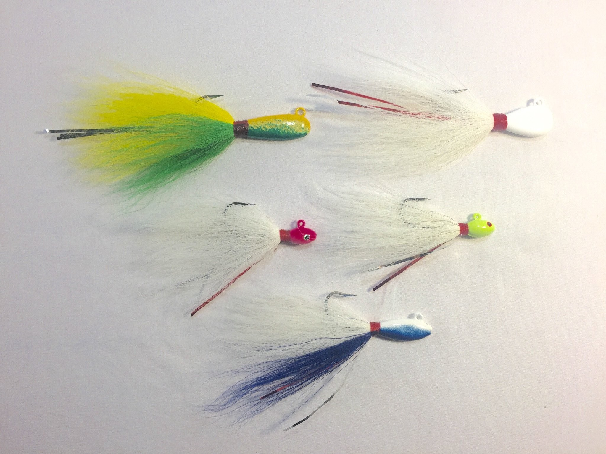 … genuine bucktail, and extremely durable powder coated head finishes.  These jigs are designed to be tough enough to withstand commercial fishing.