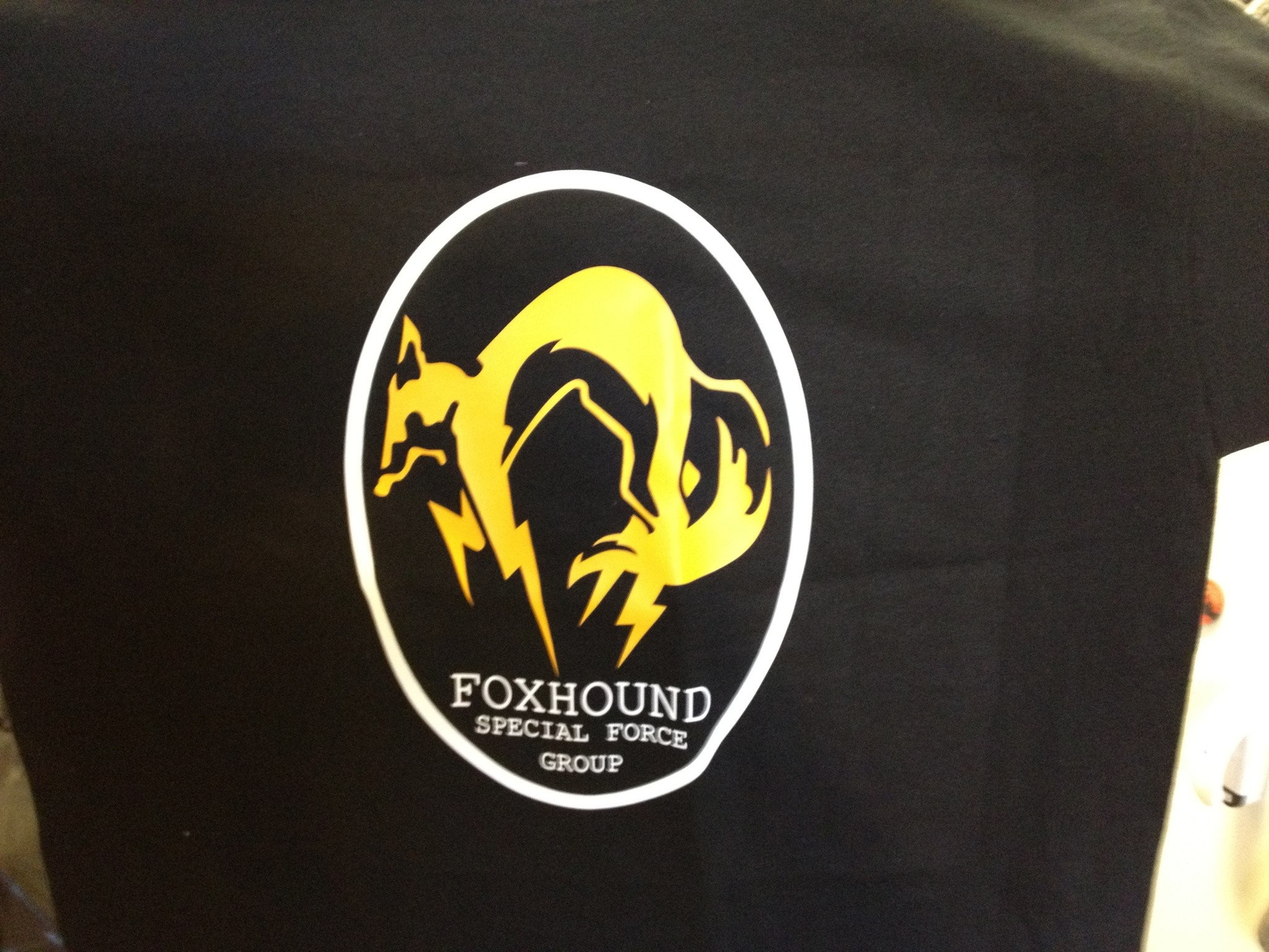 Metal Gear Solid Fox Hound Special Force Group Tshirt: Black With Yellow  and White Print
