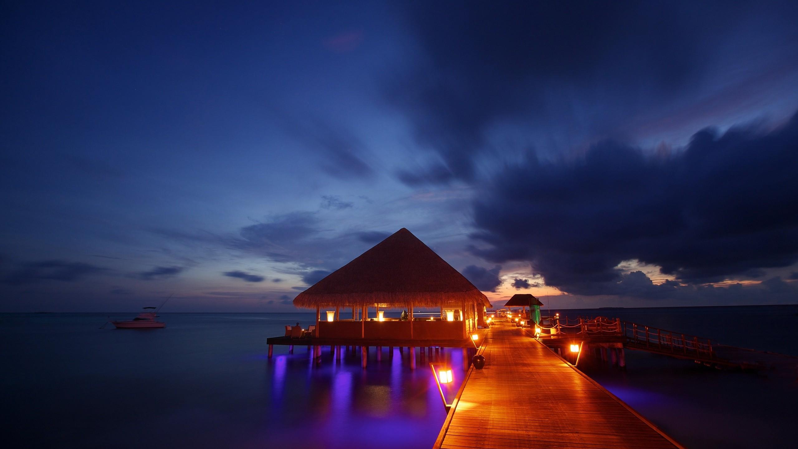night lights Maldives tropical beach bungalow ocean sea sunset reflection  wallpaper background