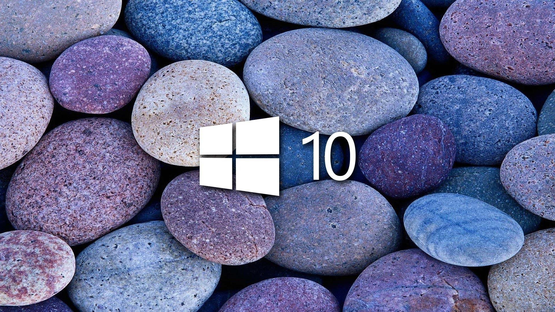 white windows 10 on blue and purple stones