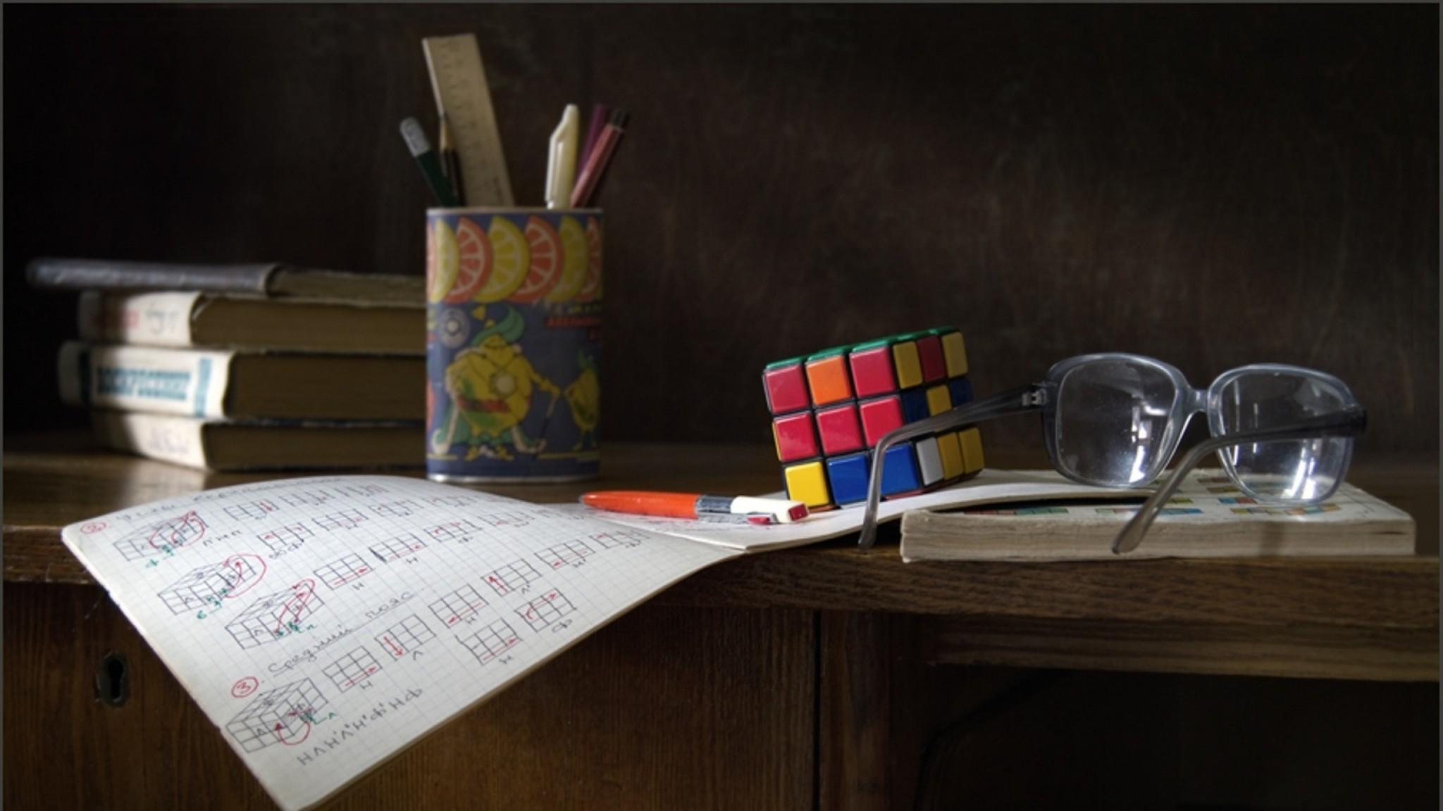 Preview wallpaper desk, glasses, instruction, rubiks cube 2048×1152