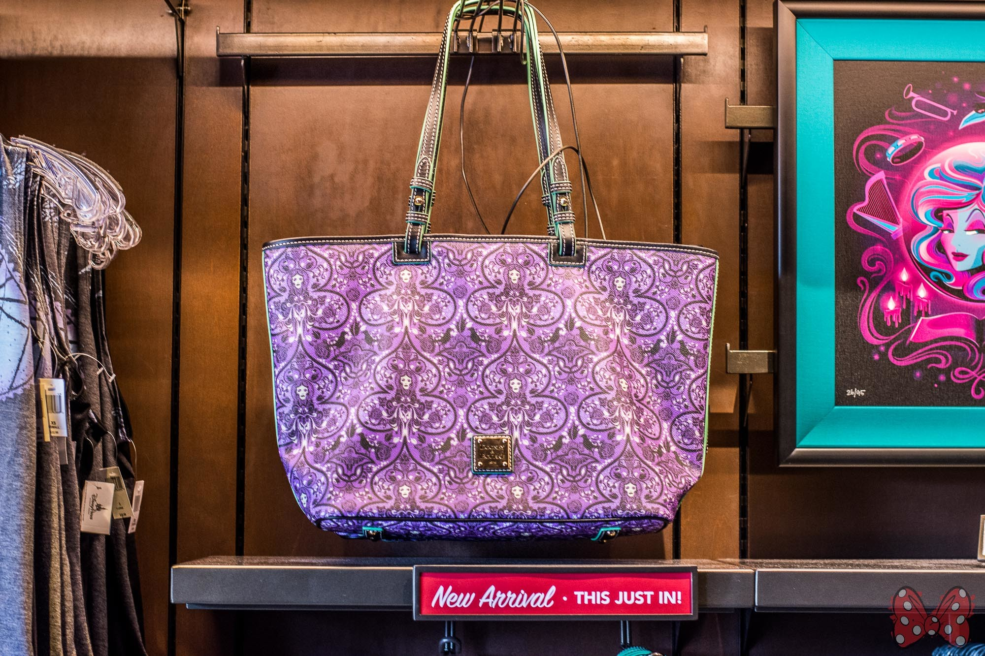 Next to the Madame Leota handbags, you will find the Haunted Mansion  Wallpaper handbags and matching Haunted Mansion Wallpaper Tank ($36.99).