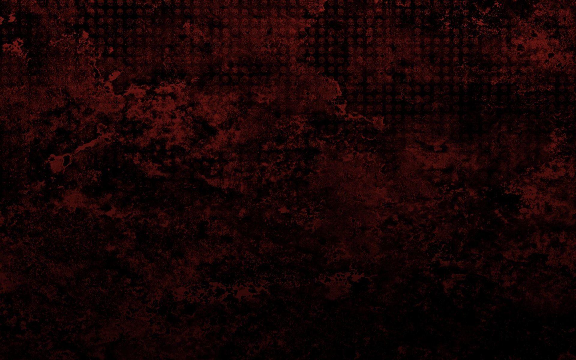 Skull pattern on a red grunge Wallpaper 28537