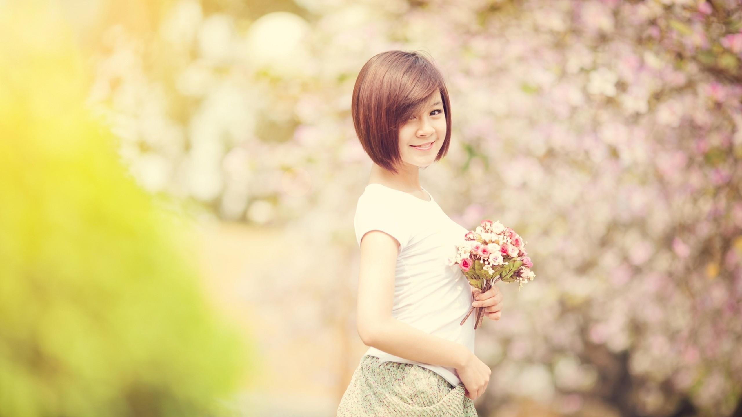 Preview wallpaper spring, girl, asian, flashing, bokeh, smile, flowers  2560×1440
