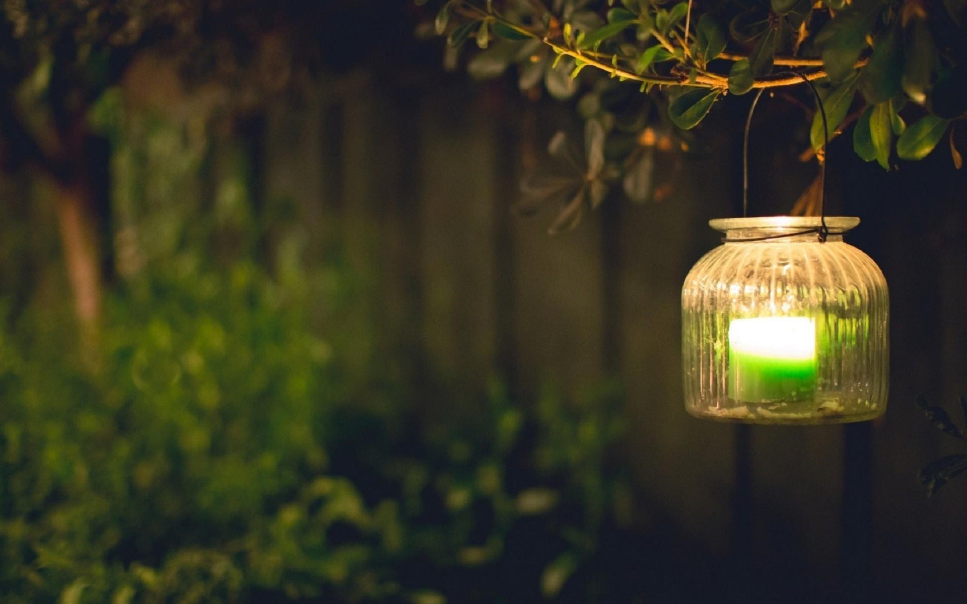 Beautiful green candle lights at night