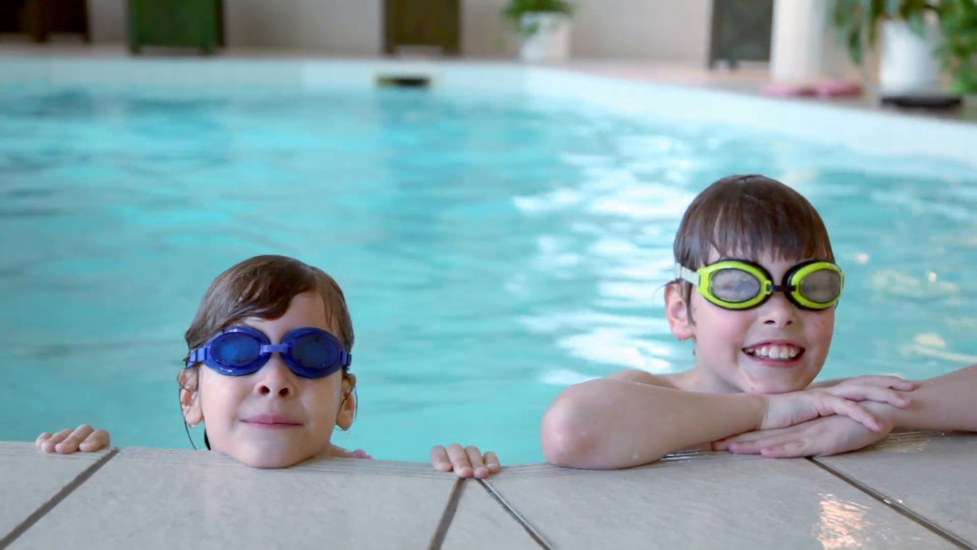 Two kids in swimming glasses stay on pool edge Stock Video Footage –  VideoBlocks