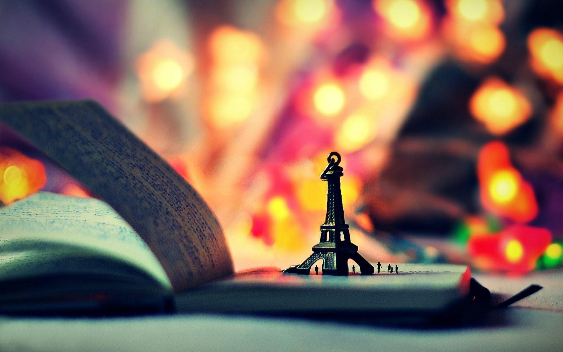 mood toys statue eiffel tower book book notebook notebook lights bokeh  background wallpaper widescreen full screen