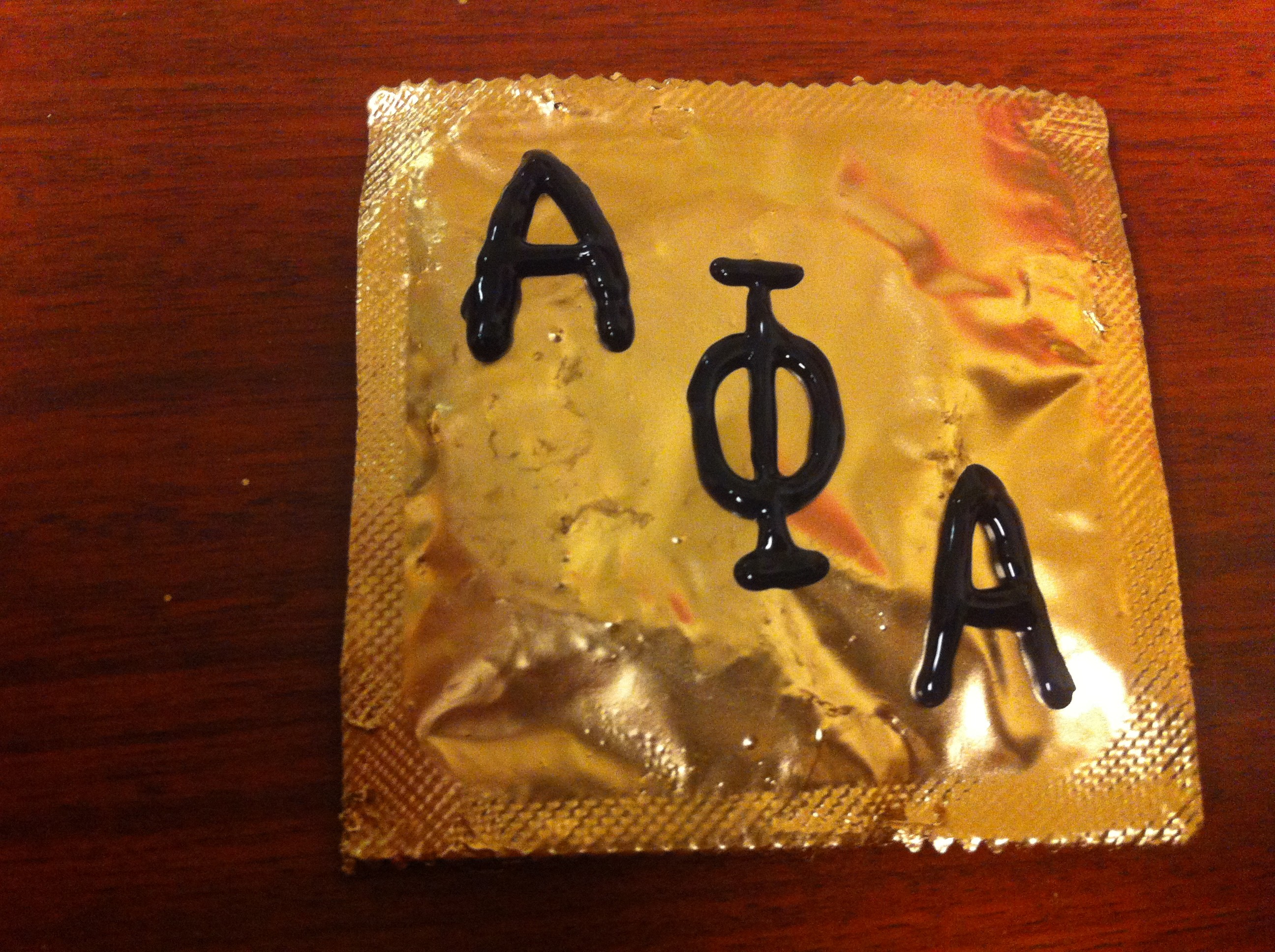 DIY Alpha Phi Alpha condoms! Simply spray paint gold condoms and use black  puffy paint