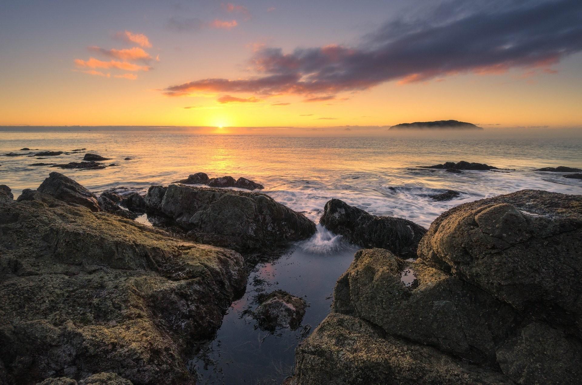tairua waikato nz new zealand ocean morning dawn horizon sun stones