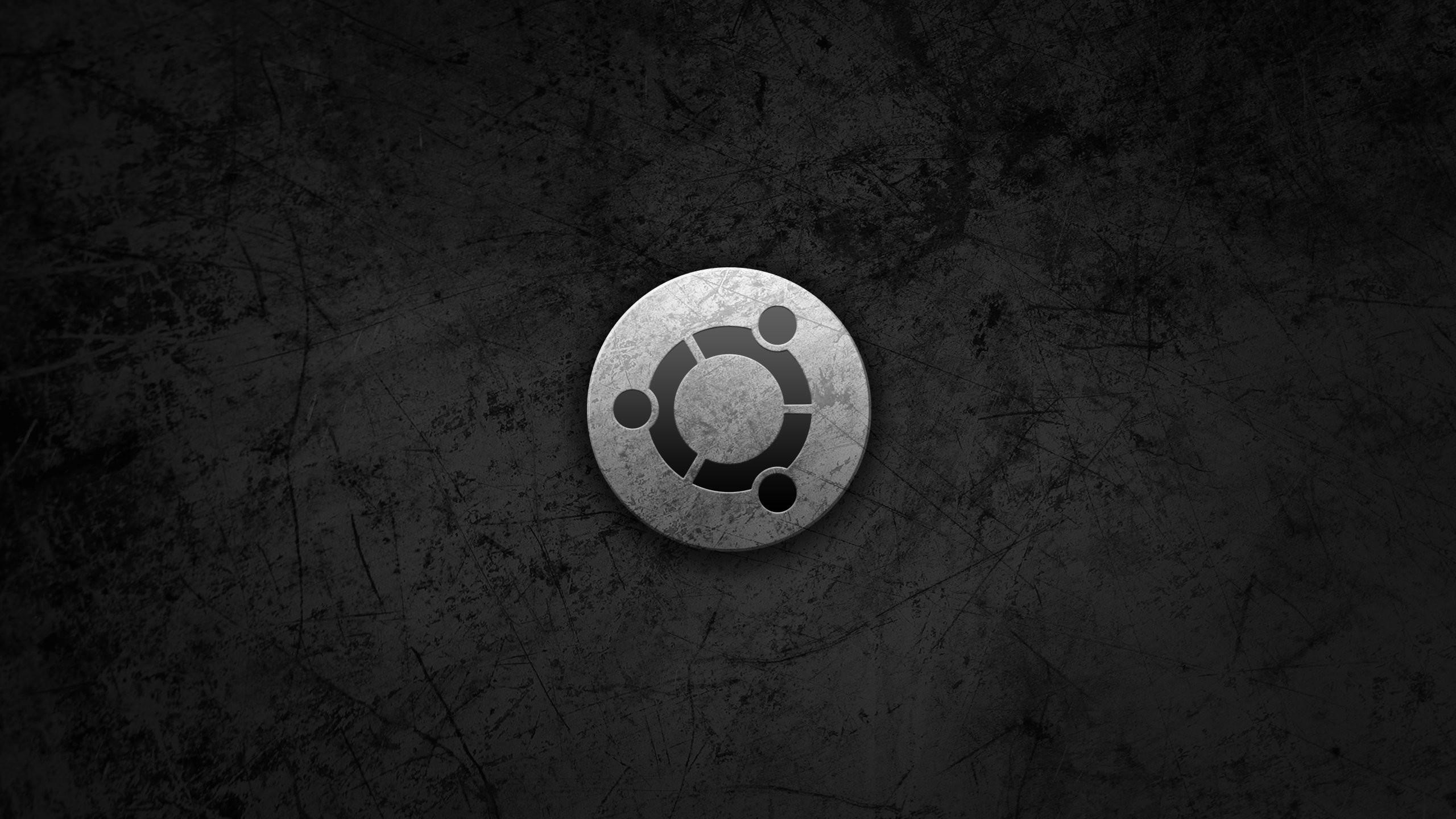 Preview wallpaper ubuntu, gray, black, circle, logo, symbol 2560×1440