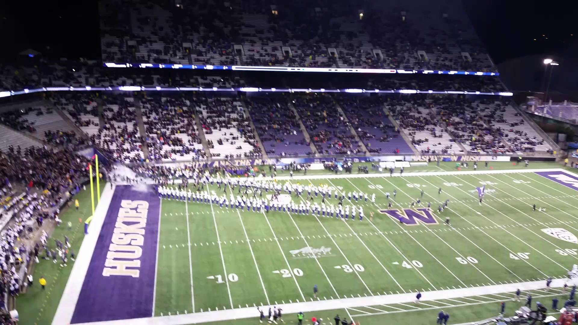 2015 University of Washington Football team Storming the field before the  game