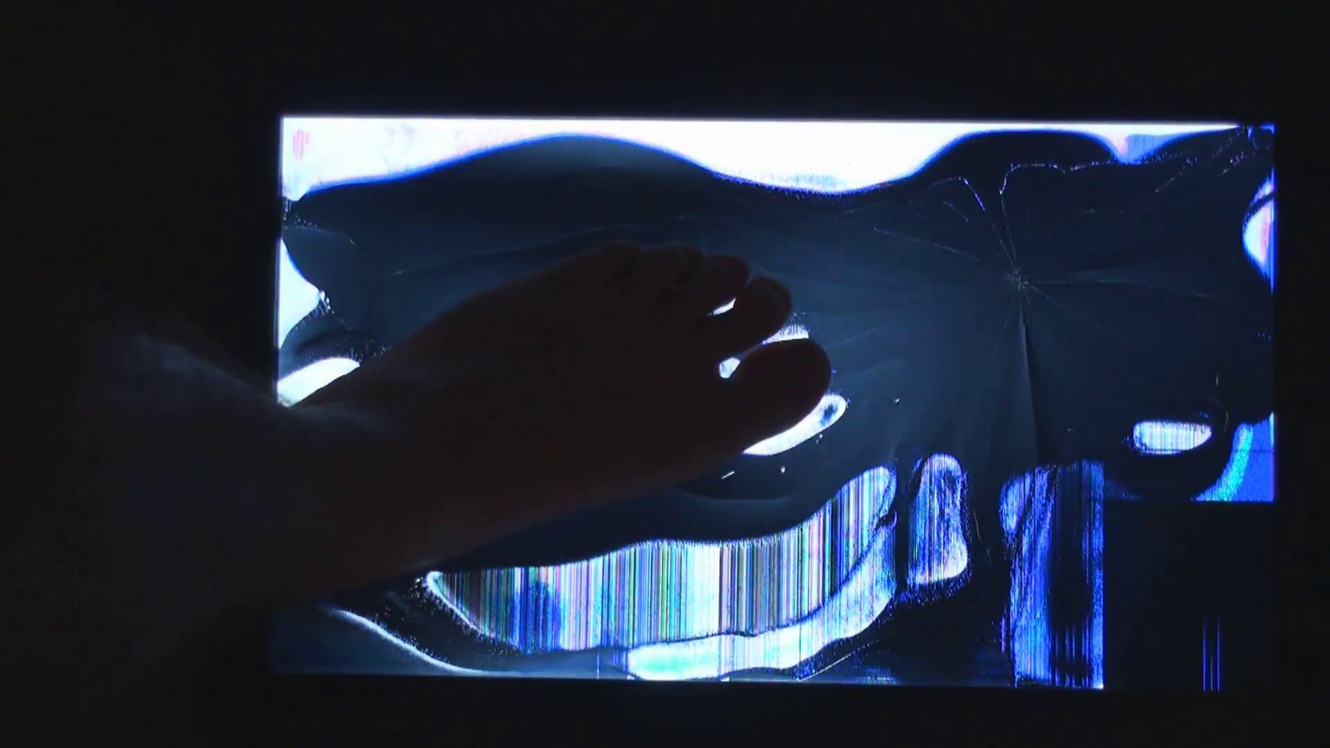 Placing a foot on broken LCD TV screen. Stock Video Footage – VideoBlocks