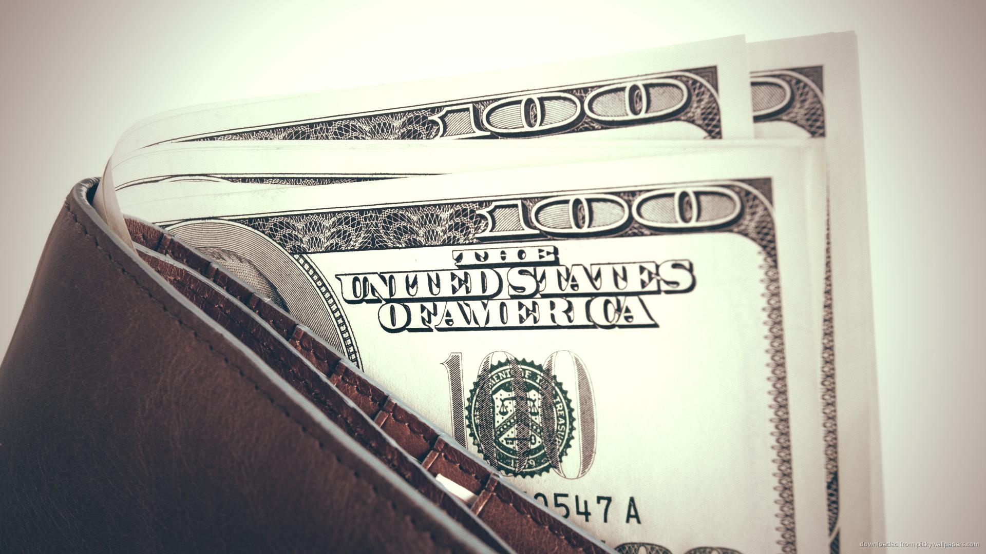 HD Wallet with a few 100 dollar bills wallpaper