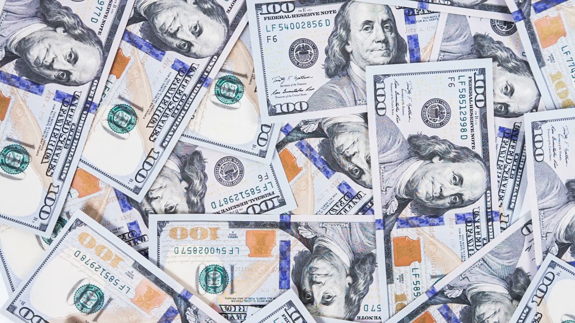Subscription Library Background with money american hundred dollar bills  rotate. RAW video record.