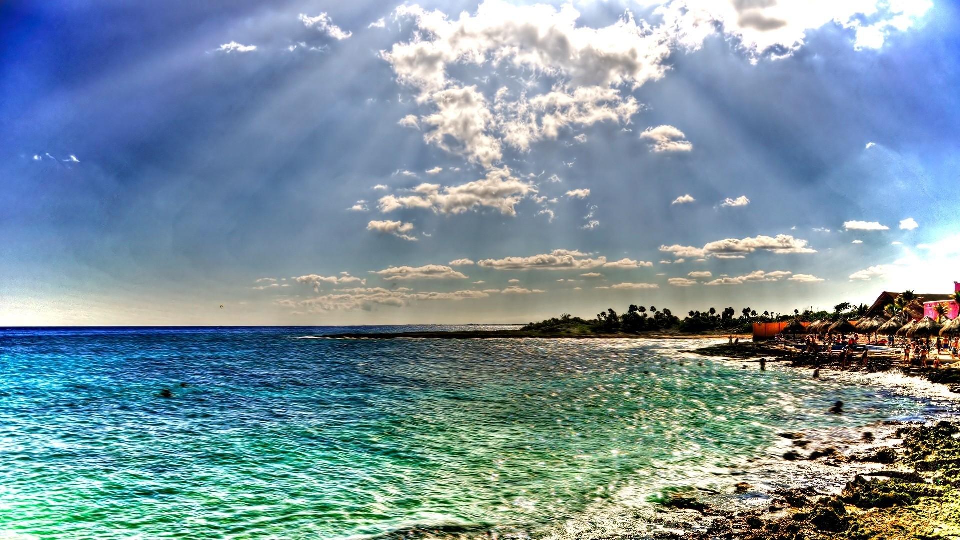 Preview wallpaper beach, sea, sun, beams, colors, coast, people 1920×1080