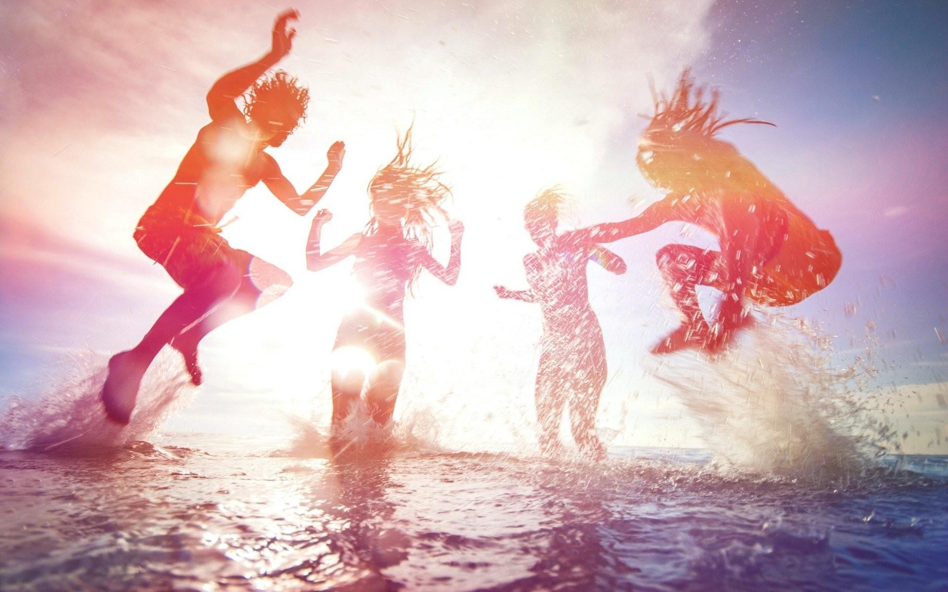 man sports sky tan people beach light june jumping friends summer ocean  foam balloon water sun