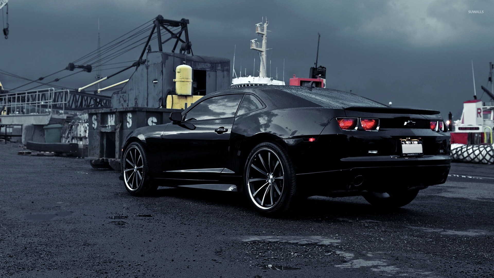 Black Chevrolet Camaro on a rainy day wallpaper