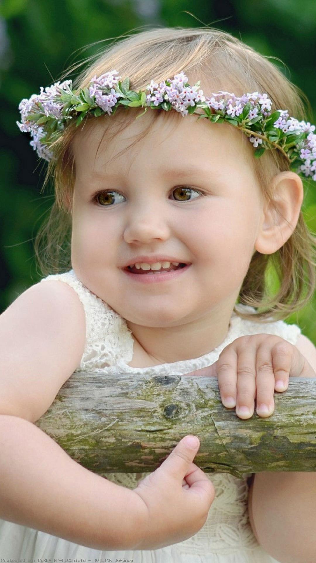 child-girl-wreath-summer-smile-wallpaper-wpt1003195