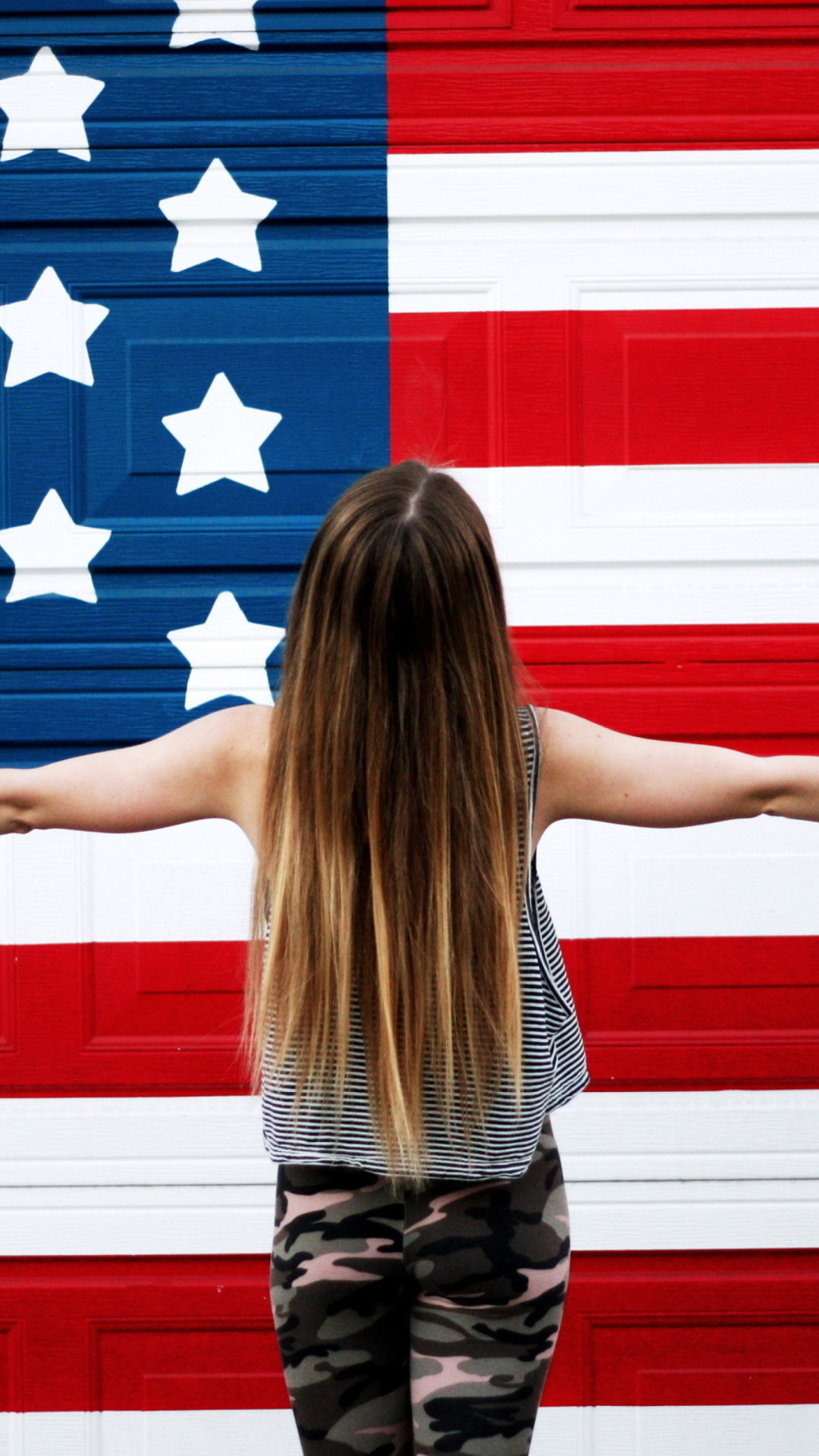 american girl in front of usa flags