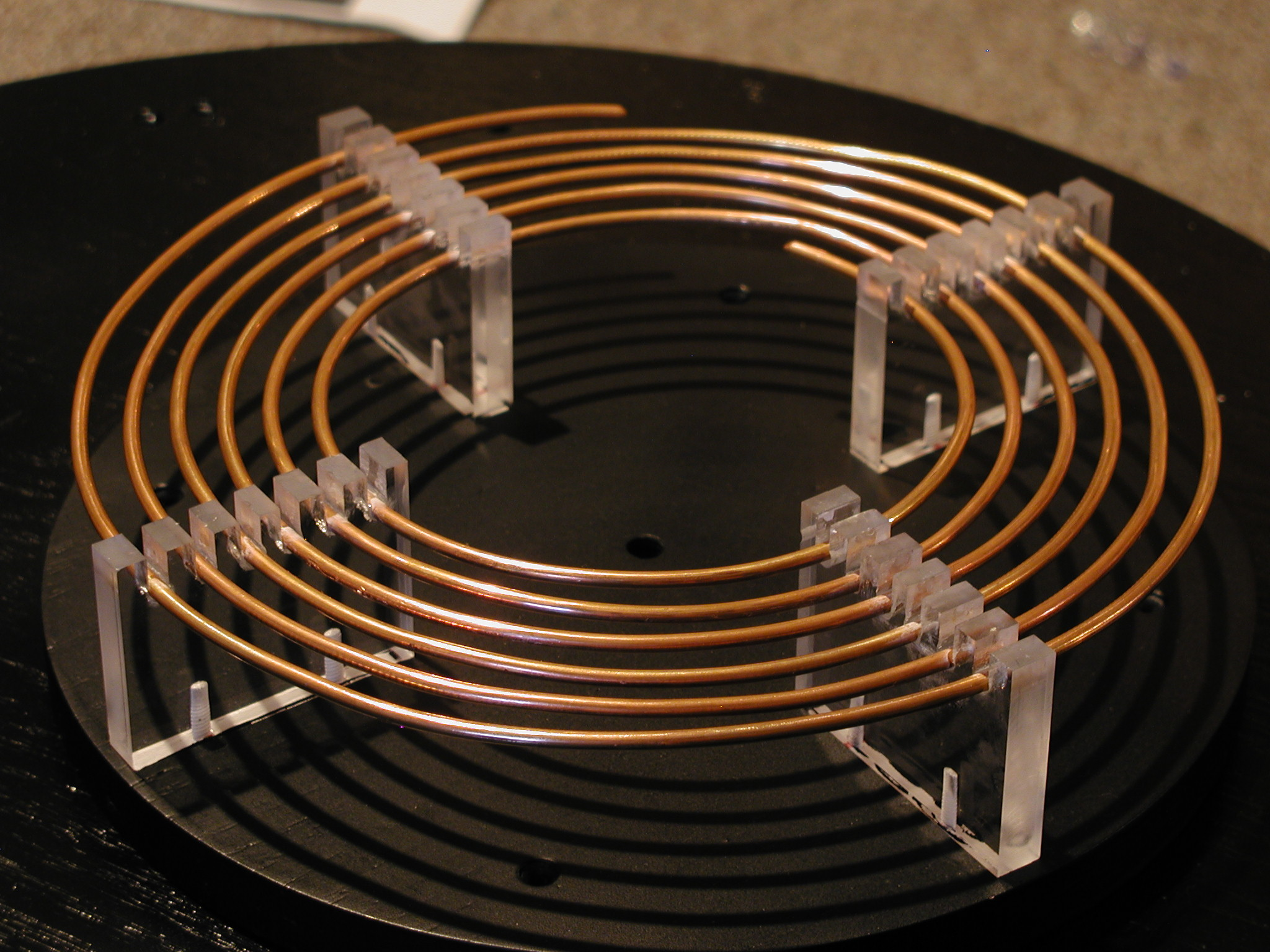 This is a here is a picture of the primary coil of my 2nd mini tesla coil,  the primary supports on the first coil. I made were removed to make a total  …