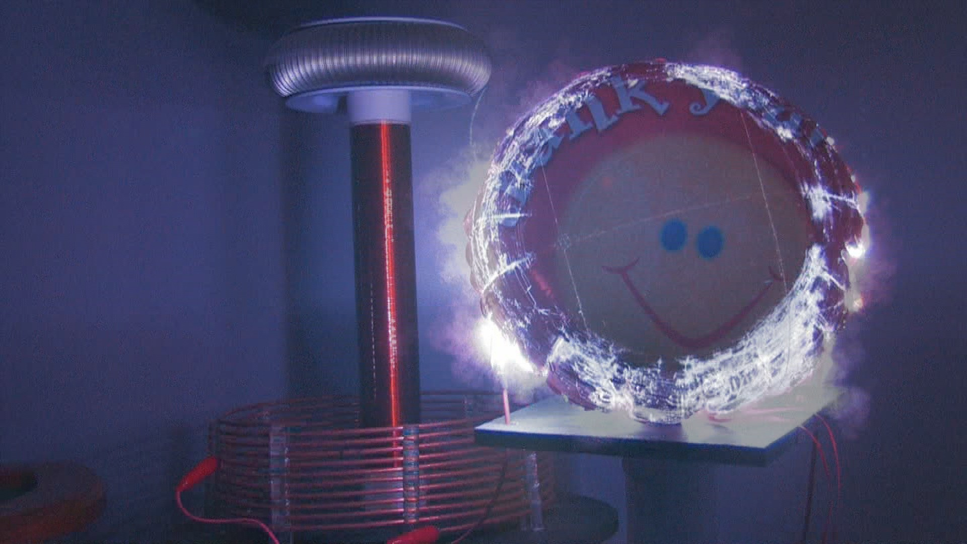 Mylar balloon meet Tesla coil, and streamers from my 250k coil.