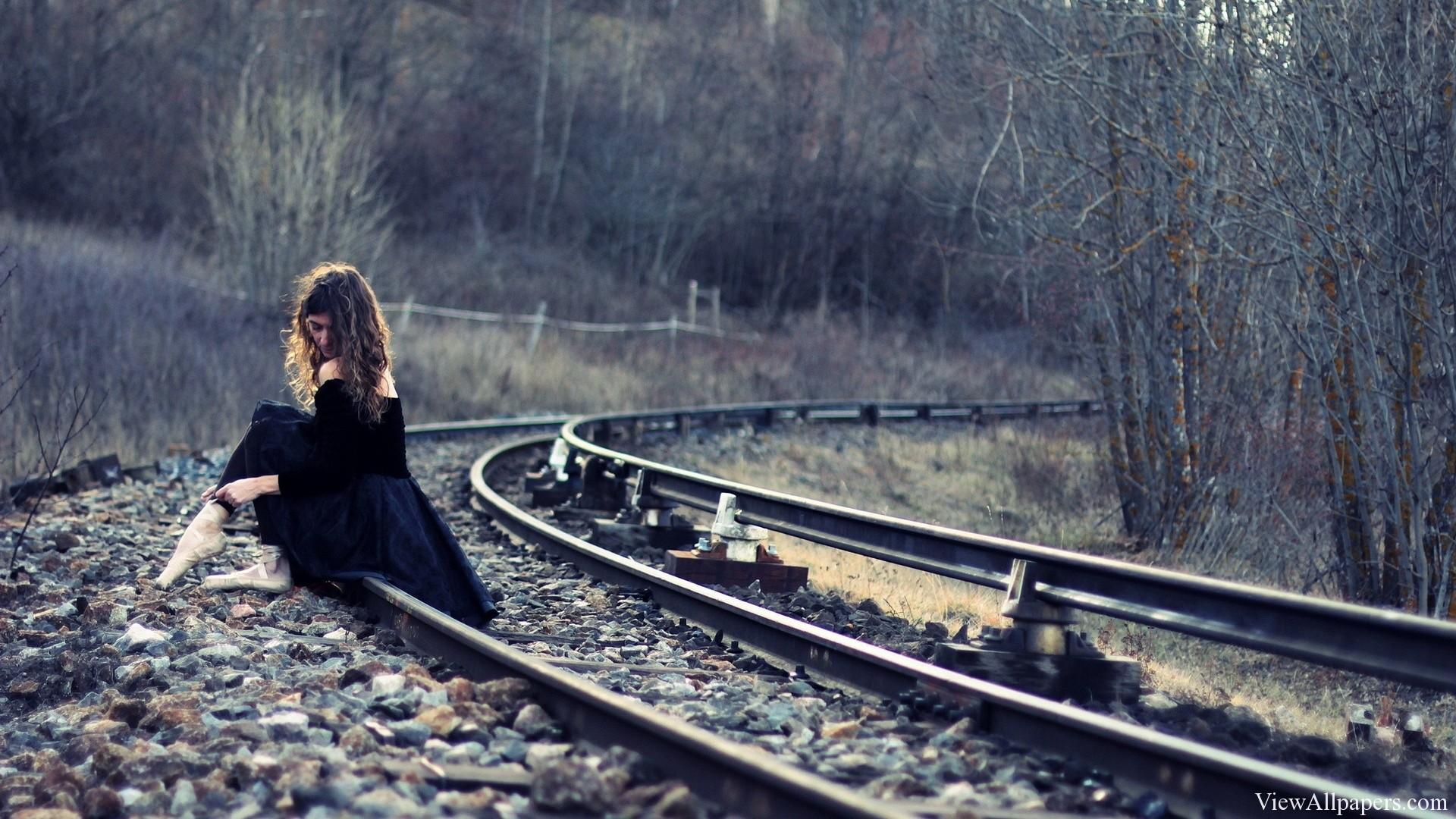 Girl Sitting On Railway Tracks