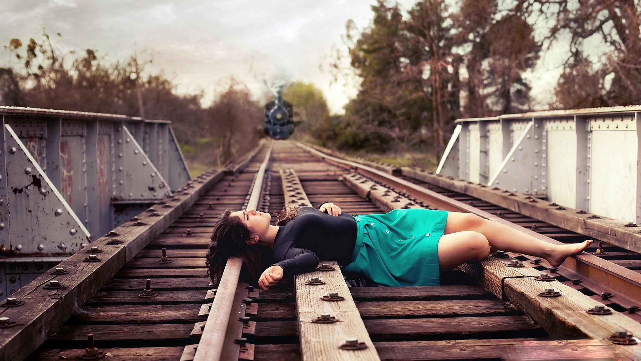 Sad Girl Lying on Railway Track