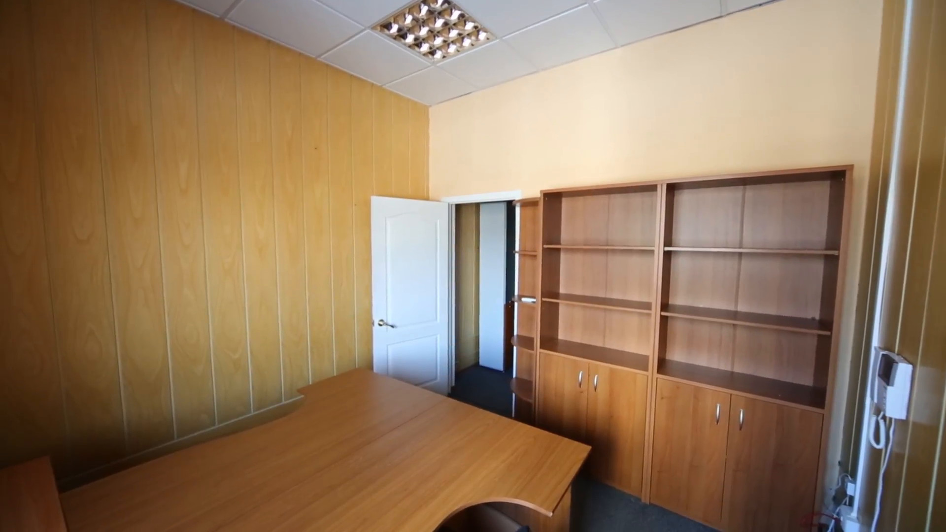 A small office room with a work desk and empty cabinets Stock Video Footage  – VideoBlocks