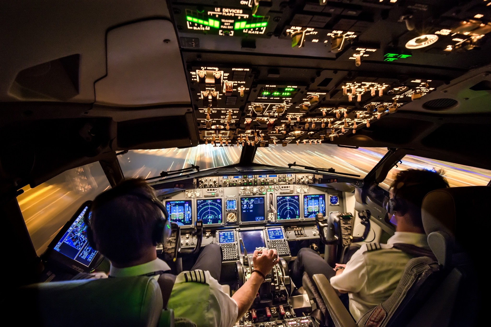 "Arke/Arkefly photo taken by Martijn Kort – Our office during a night  landing in Amsterdam – Schiphol. ""Cockpit view Boeing at night"""