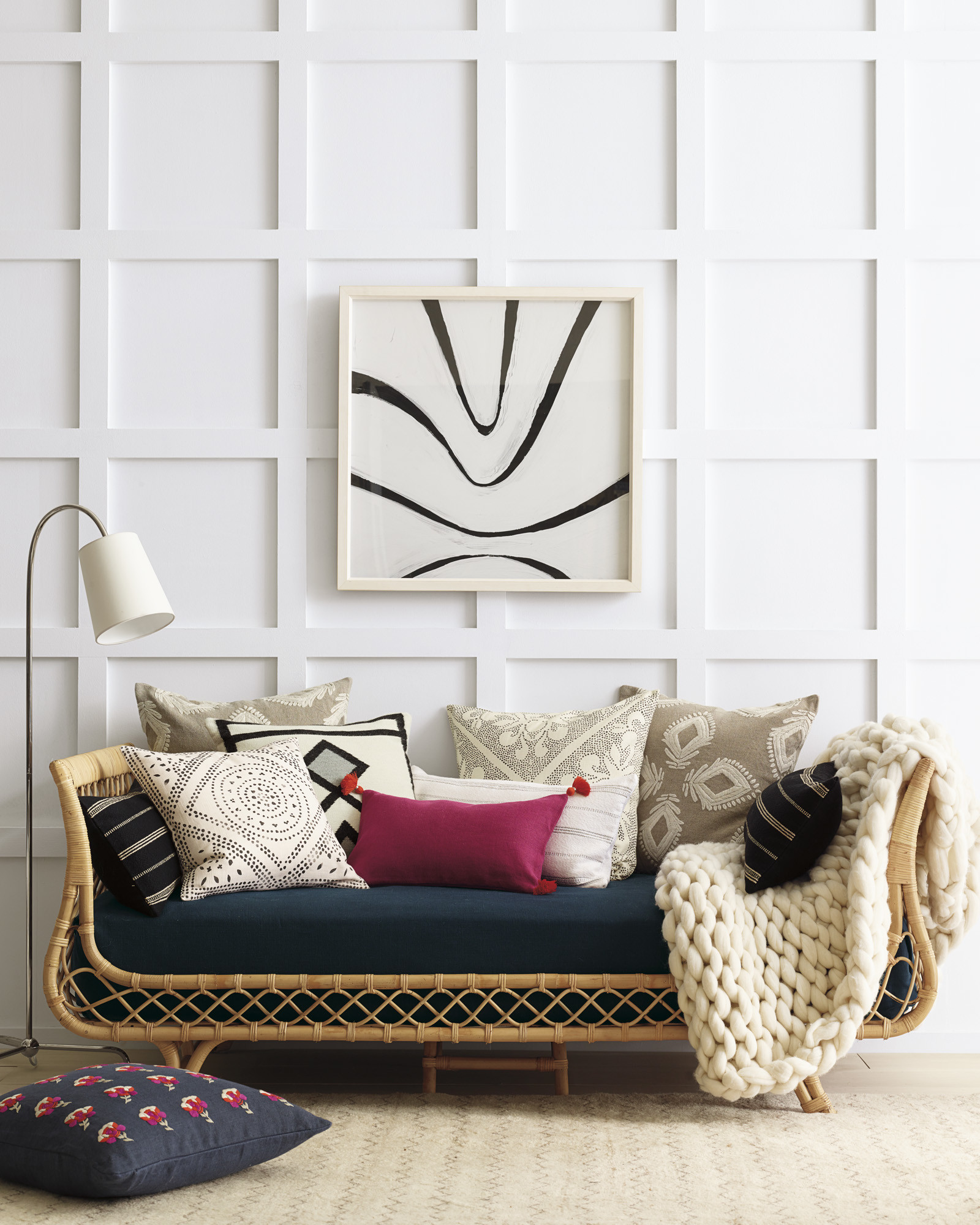 Love this rattan daybed with a mix of colorful pillows