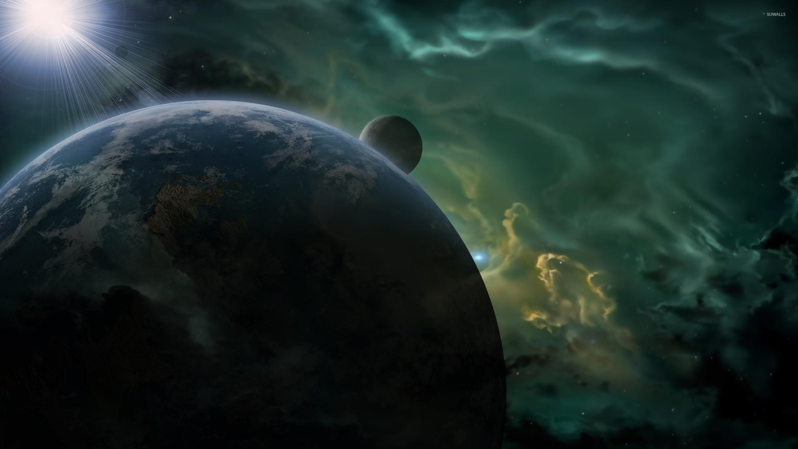 Bright light shining upon the blue planet wallpaper jpg