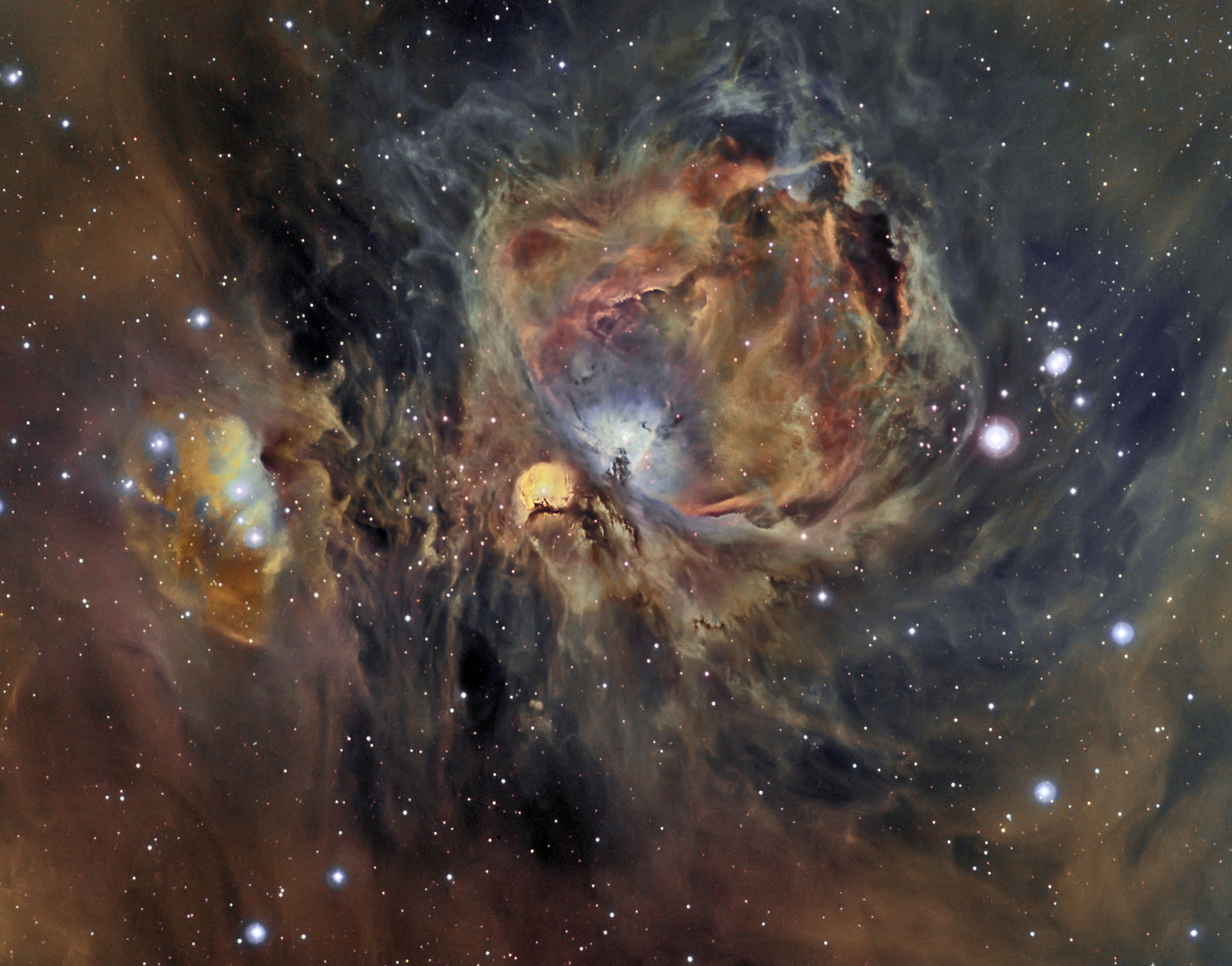 The Nebula's glowing gas surrounds hot young stars at the edge of an  immense interstellar molecular