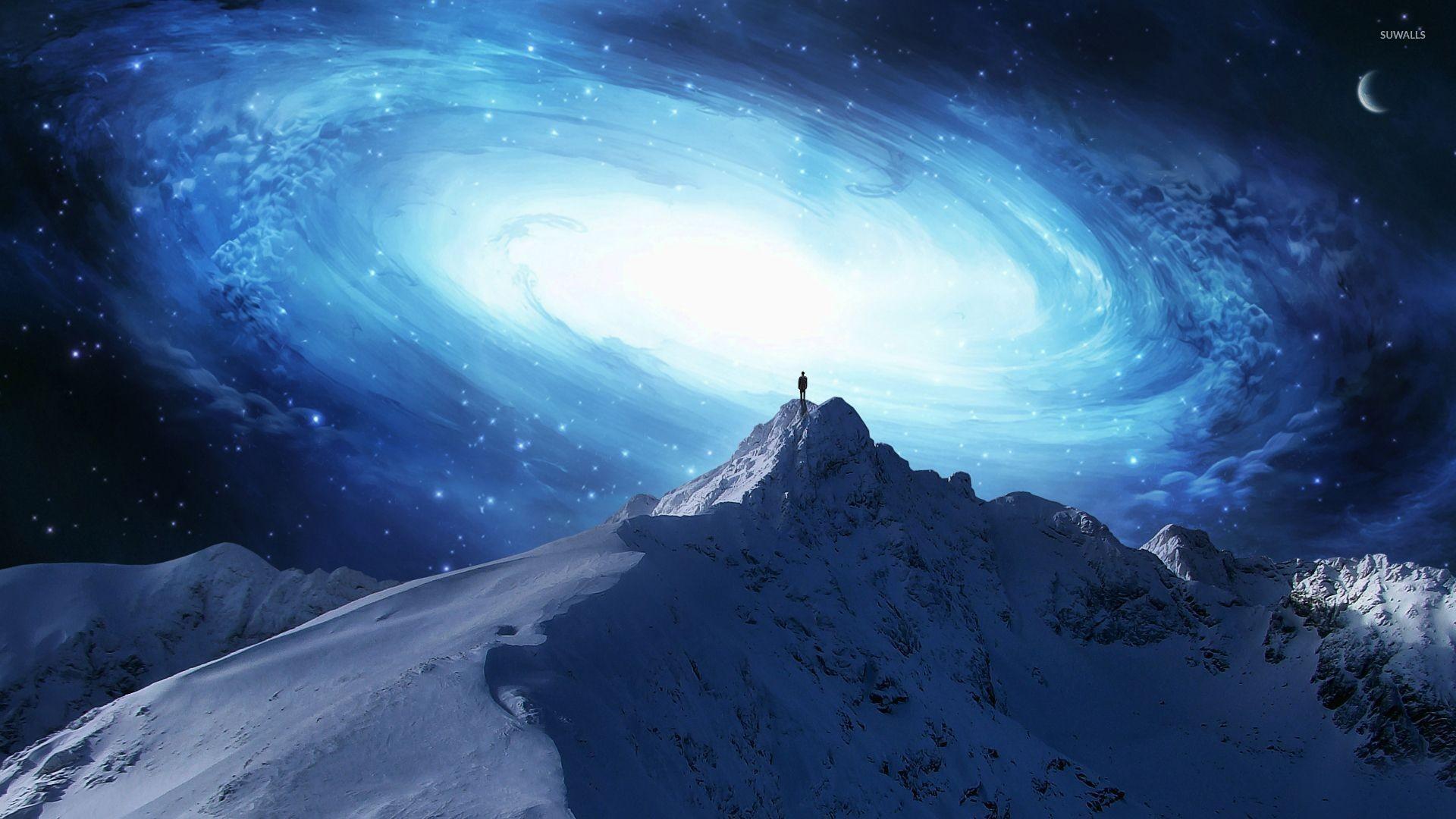 Man on the mountain peak overlooking the galaxy wallpaper jpg