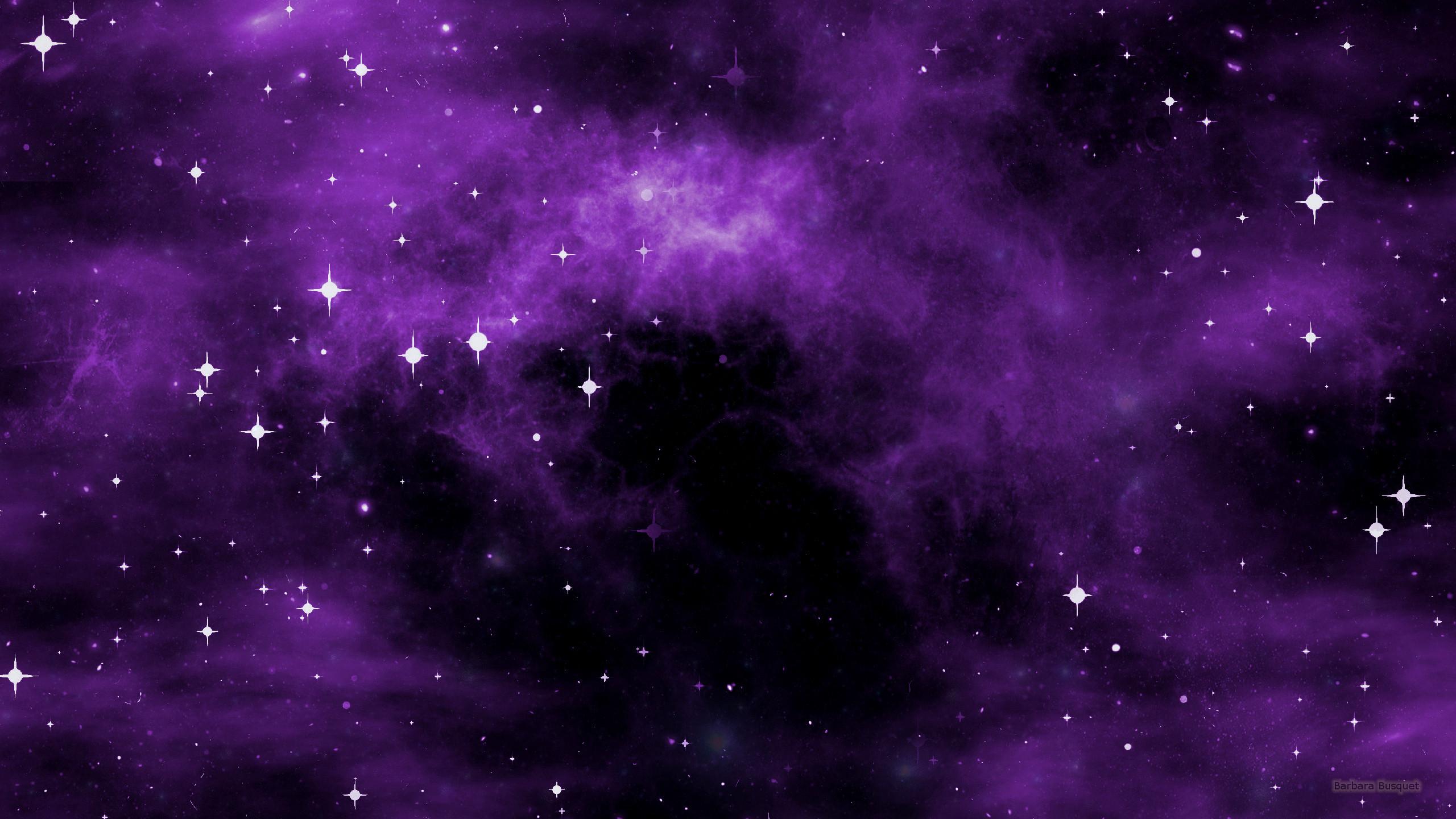 Space wallpaper with purple nebula.