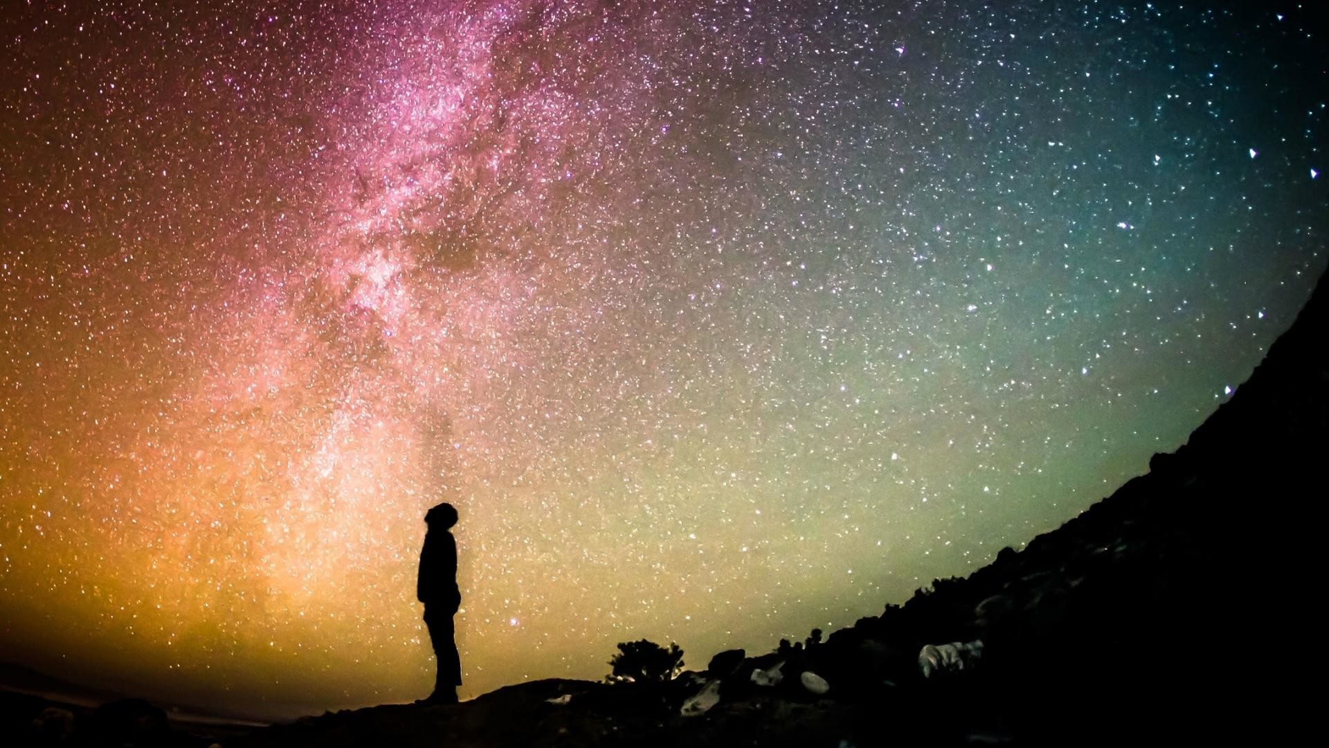Title. Man looking up the starry night sky