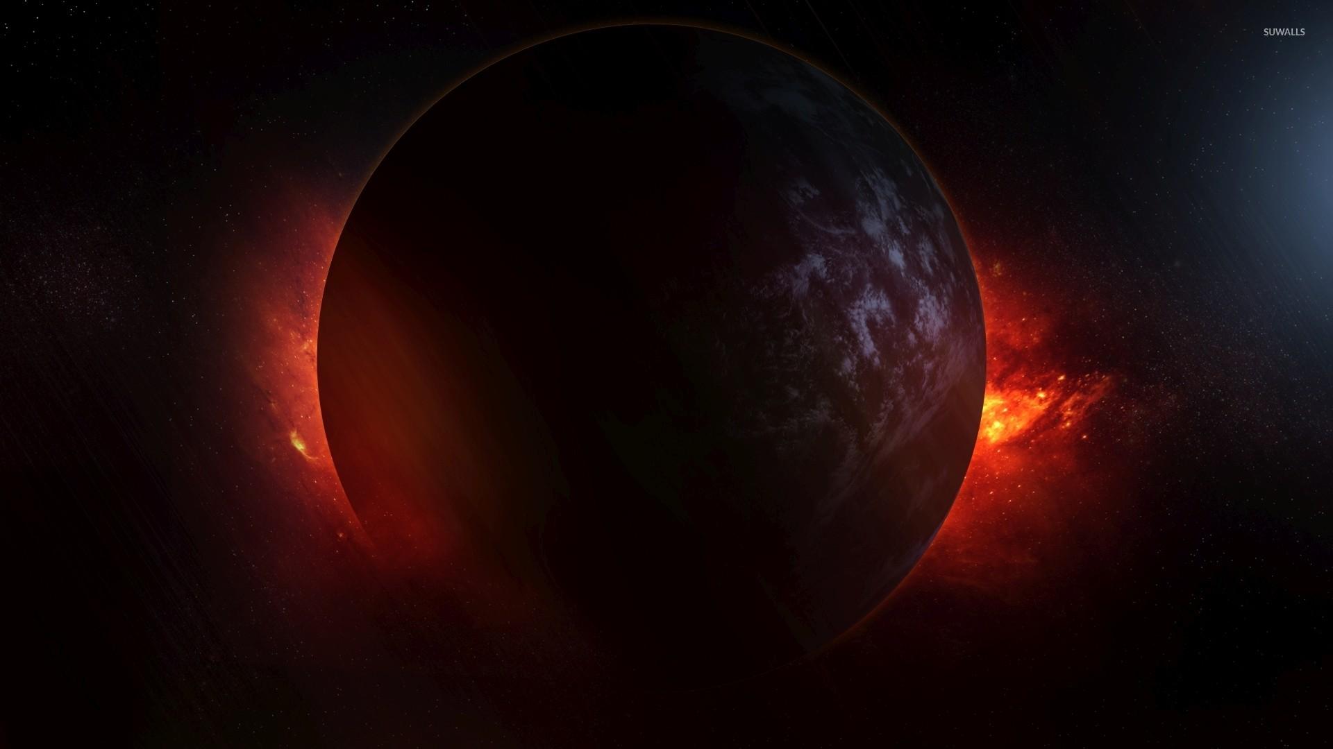 Red nebula hiding behind the dark planet wallpaper