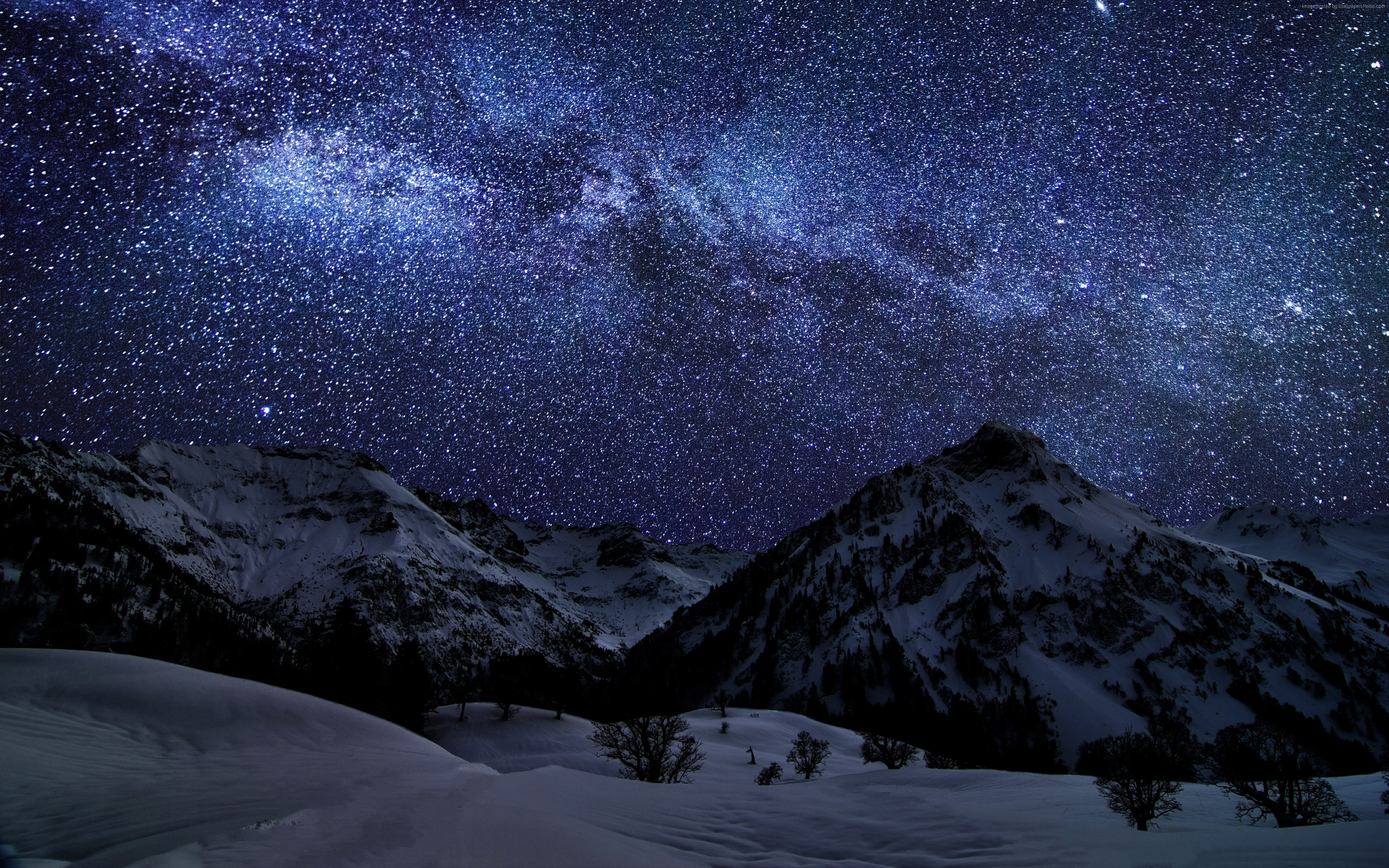 Rocky mountains and the starry night sky wallpaper