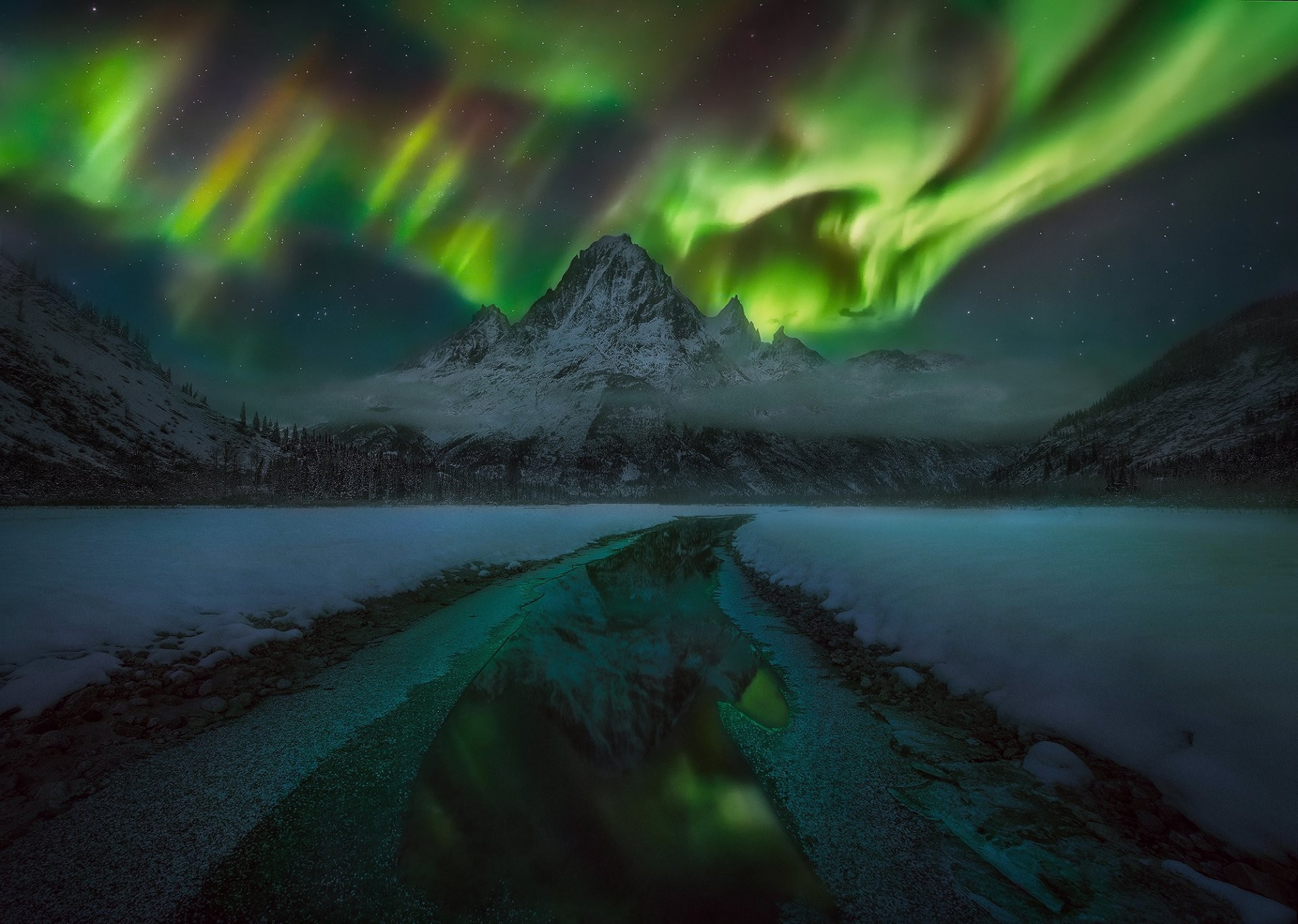 winter night sky star northern lights mountain clouds forest snow water  reflection