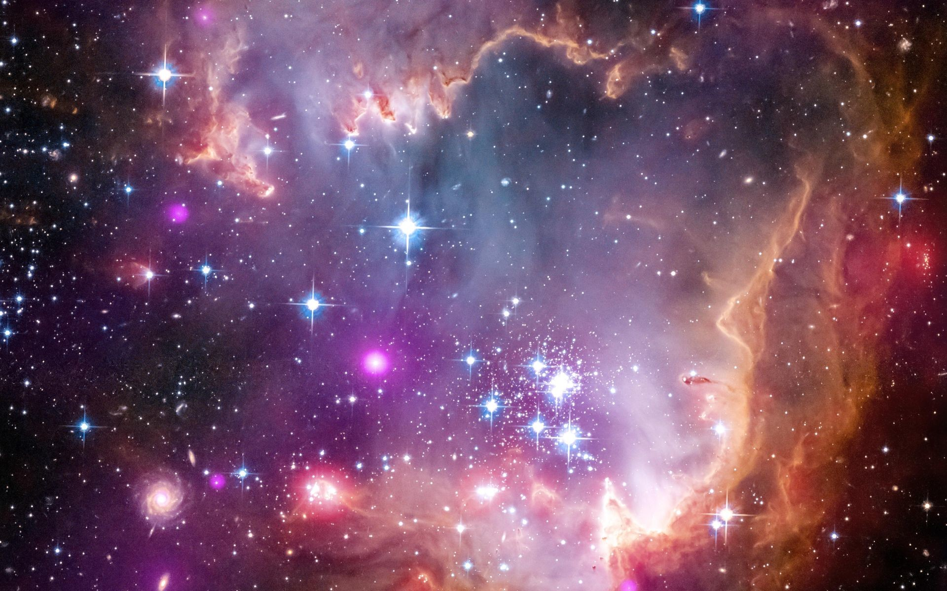 The tip of the 'wing' of the Small Magellanic Cloud galaxy is dazzling in