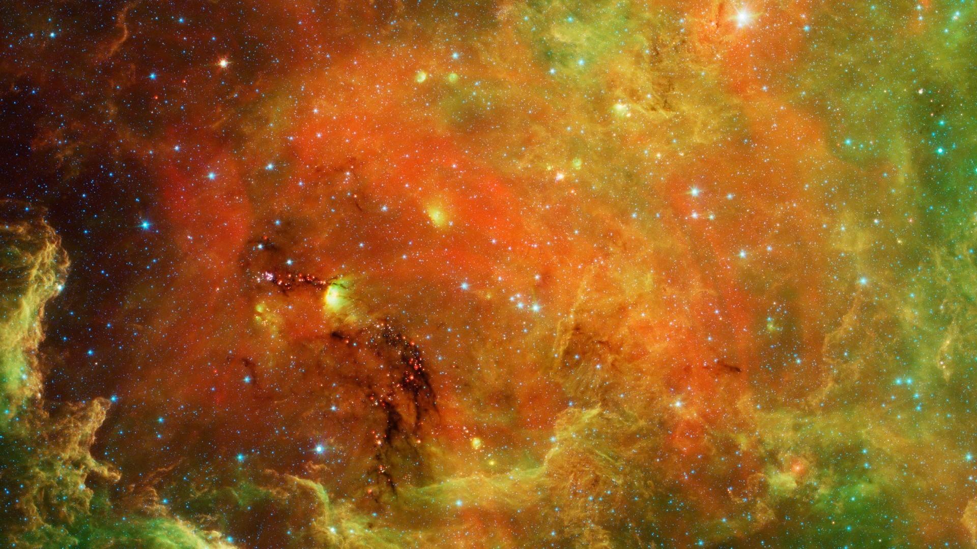 wallpaper orange green nebula and cluster of stars.
