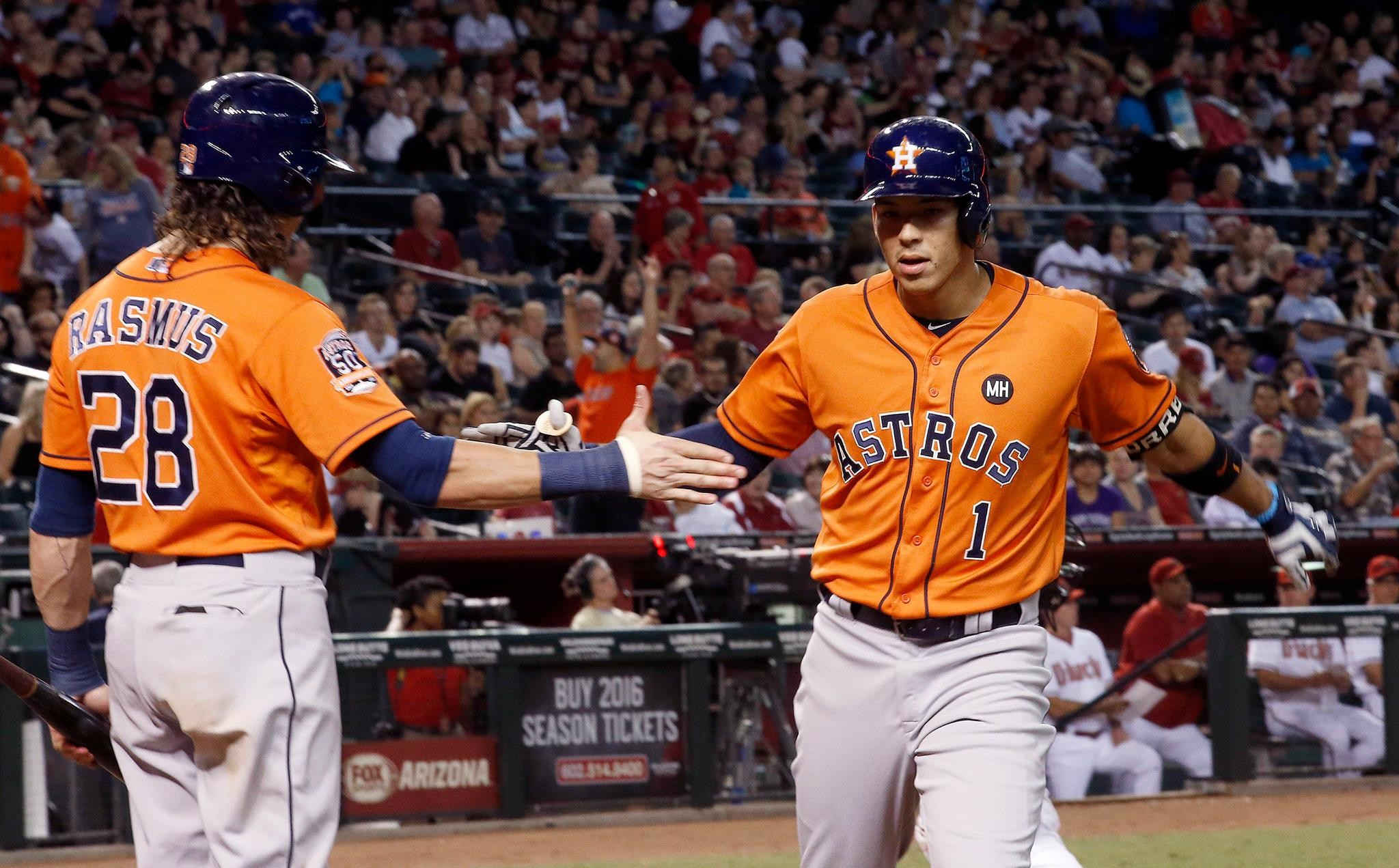 Colby Rasmus congratulates Carlos Correa after a record-breaking 22nd  homerun of the season.