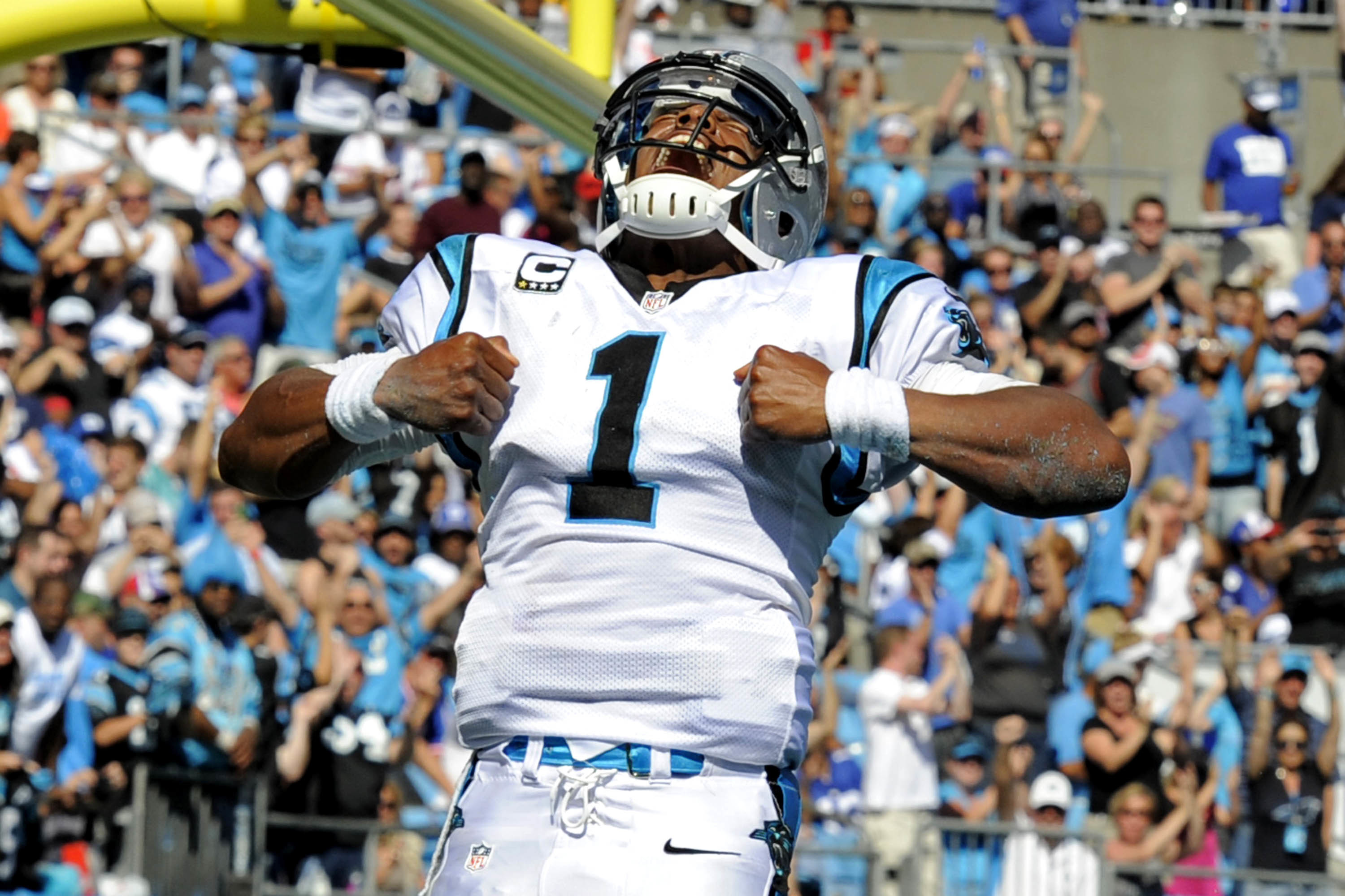 Cam Newton celebrates a TD run in the Panthers' 38-0 drubbing of the