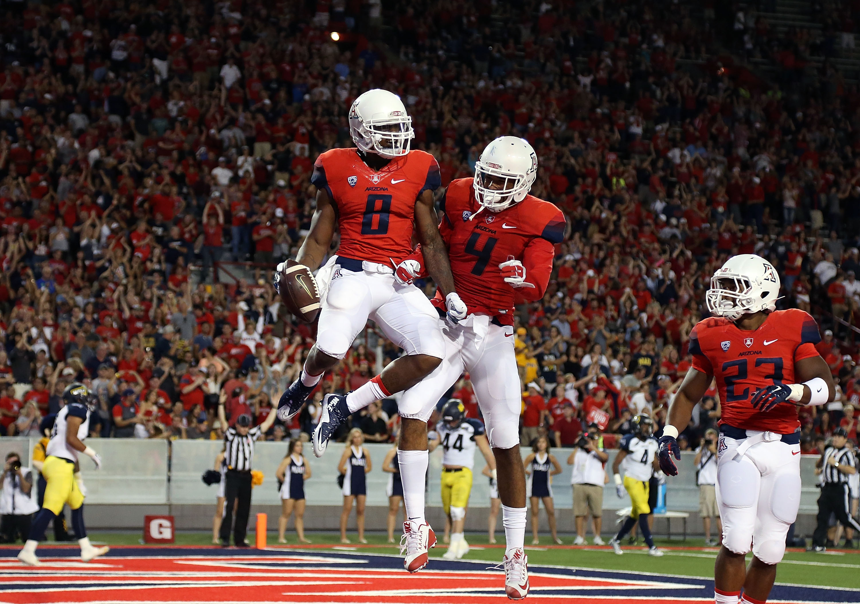 (Source) U of A's alternate home uniforms worn in a 77-13 win over Northern  Arizona.