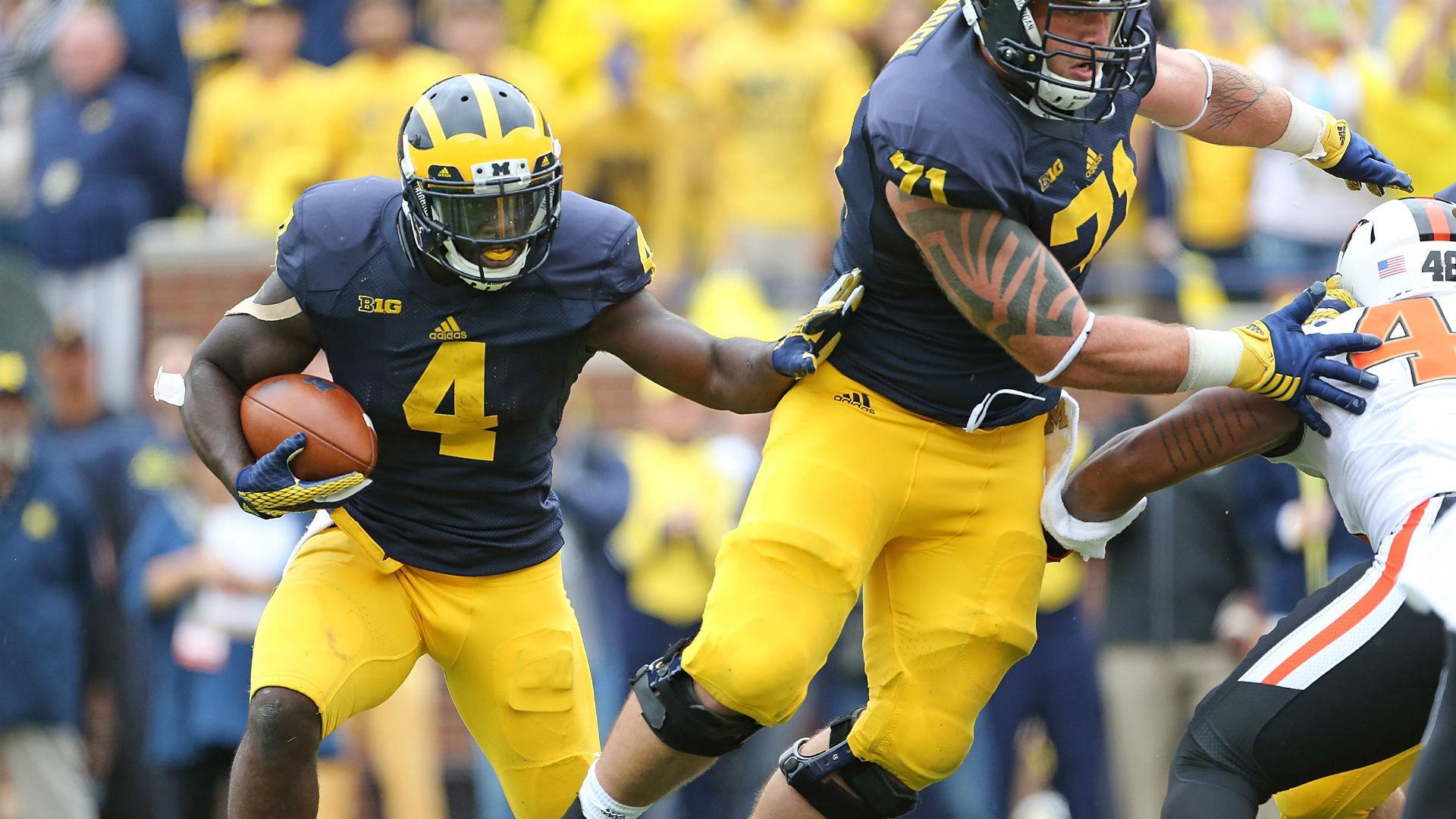 The Michigan way: Punish with power run game | NCAA Football | Sporting News
