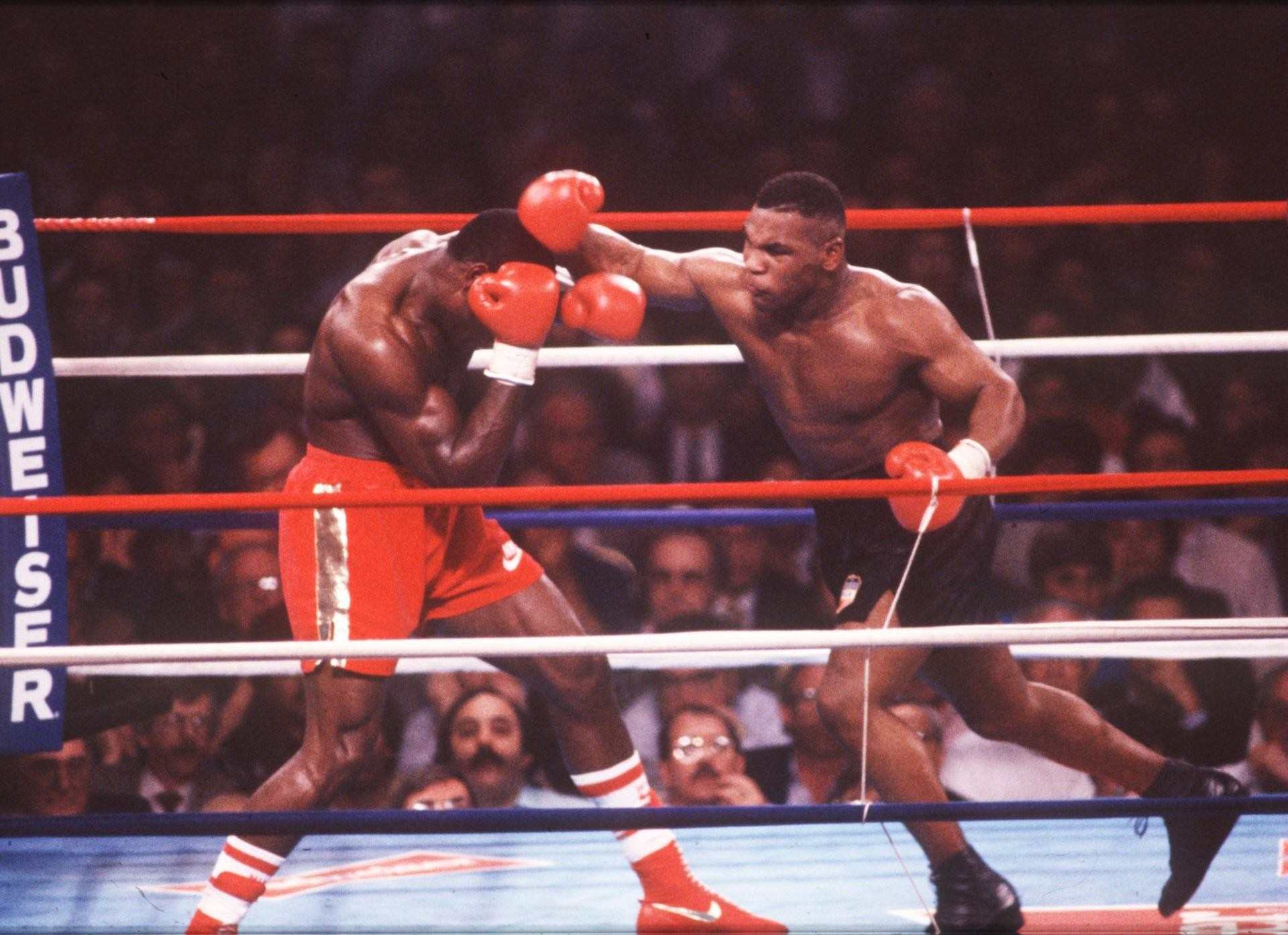 Famous boxer Mike tyson in the ring wallpapers and images .