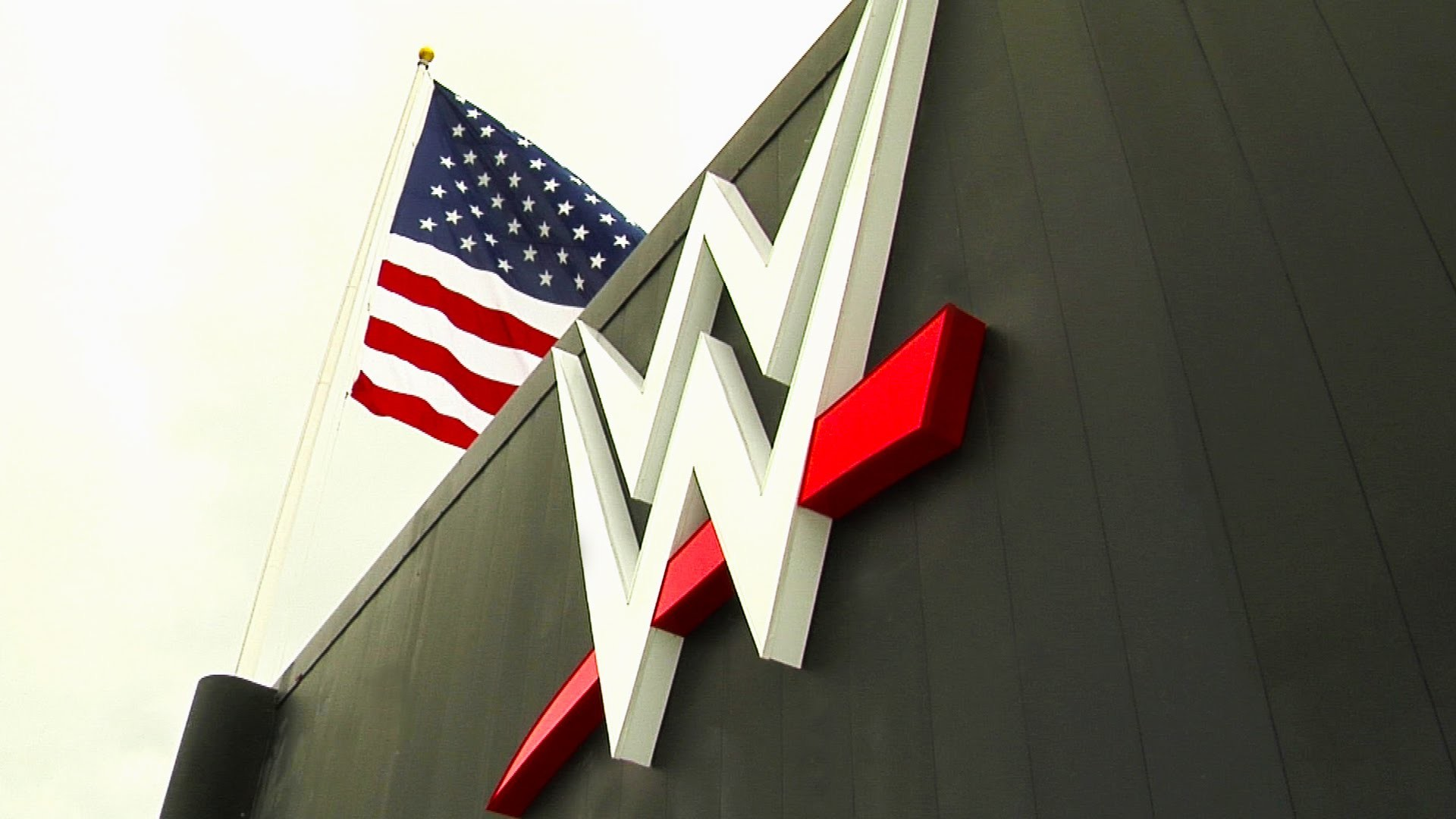 WWE Headquarters has a fresh look with the arrival of the new WWE logo:  August 18, 2014 – YouTube