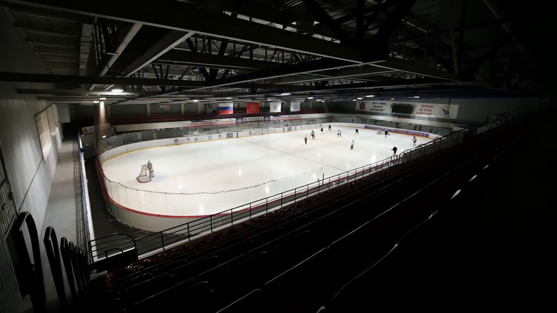 View from dark left tribune on hockey on covered ice rink. Slow motion  Stock Video Footage – VideoBlocks