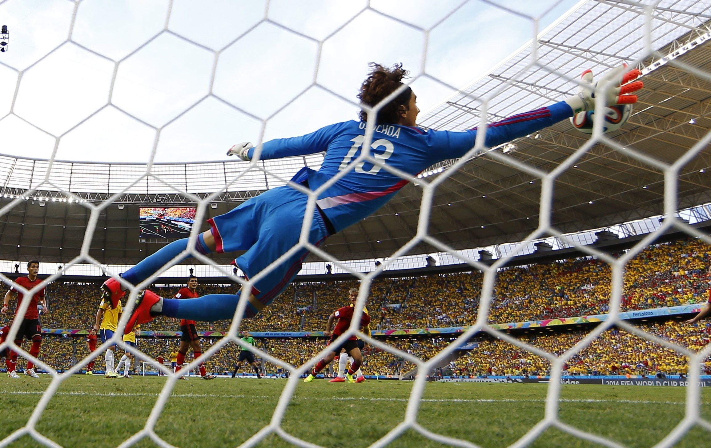 … Mexico goalkeeper Guillermo Ochoa makes a save on a shot by Brazil's  Neymar during Tuesday's match