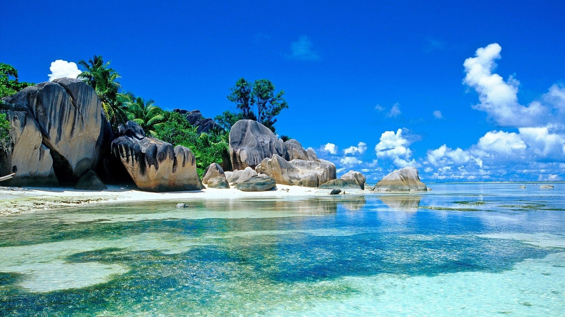 Free Beach Screensavers And Wallpapers Tropical Beach With Large Rocks .